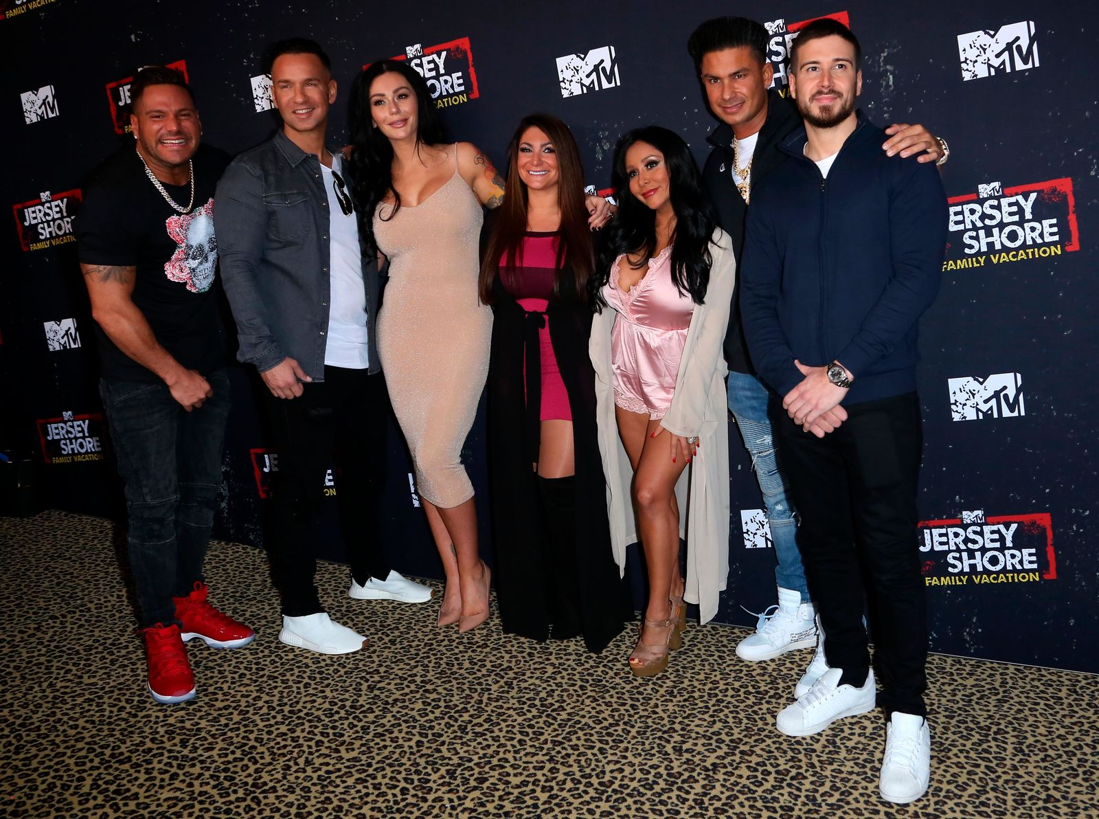 "Ronnie Ortiz-Magro, from left, Mike 'The Situation' Sorrentino, Jenni 'Jwoww' Farley, Deena Nicole Cortese, Vinny Guadagnino, Paul 'Pauly D' DelVecchio and Nicole Polizzi arrive at the LA Premiere of ""Jersey Shore Family Vacation"" on Thursday, March 29, in Los Angeles. (Photo by Willy Sanjuan/Invision/AP)"