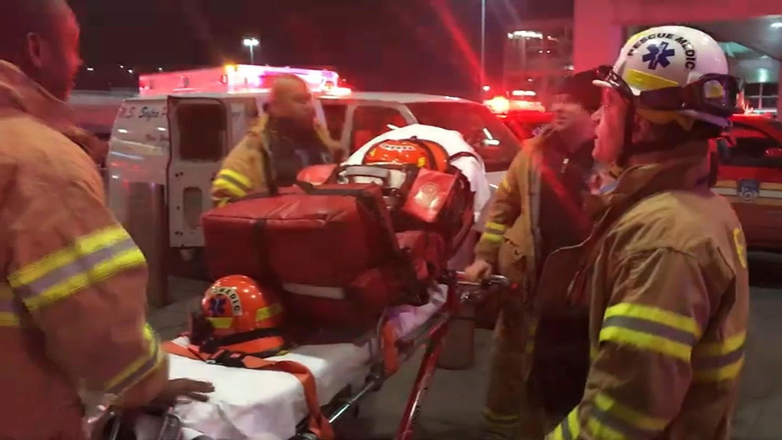 In this still image taken from video provided by WNBC-TV News 4 New York, emergency medical personnel work at New York's John F. Kennedy International Airport, Saturday, March 9, 2019.{ } (WNBC-TV News 4 New York via AP)