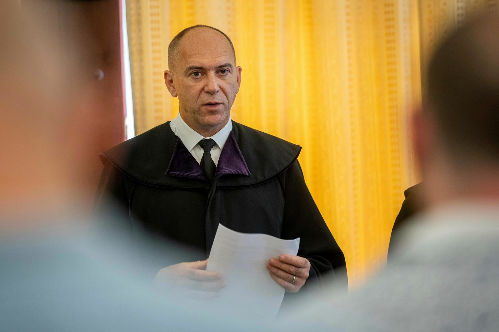 Judge Erik Mezolaki announces the second verdict in the migrant smuggling case known as the Parndorf-case in the Court of Appeal of Szeged in Szeged, southern Hungary, Thursday, June 20, 2019. (Tibor Rosta/MTI via AP)