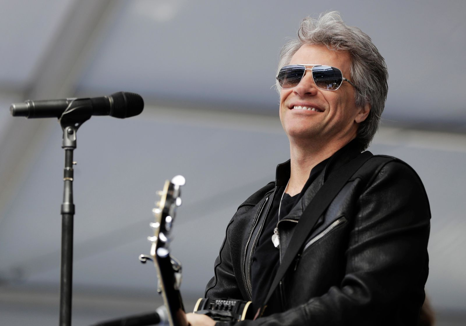 FILE - In this May 16, 2017 file photo, musician Jon Bon Jovi performs during a surprise appearance at the Fairleigh Dickinson University commencement ceremony at MetLife Stadium in East Rutherford, N.J. (AP Photo/Julio Cortez, File)