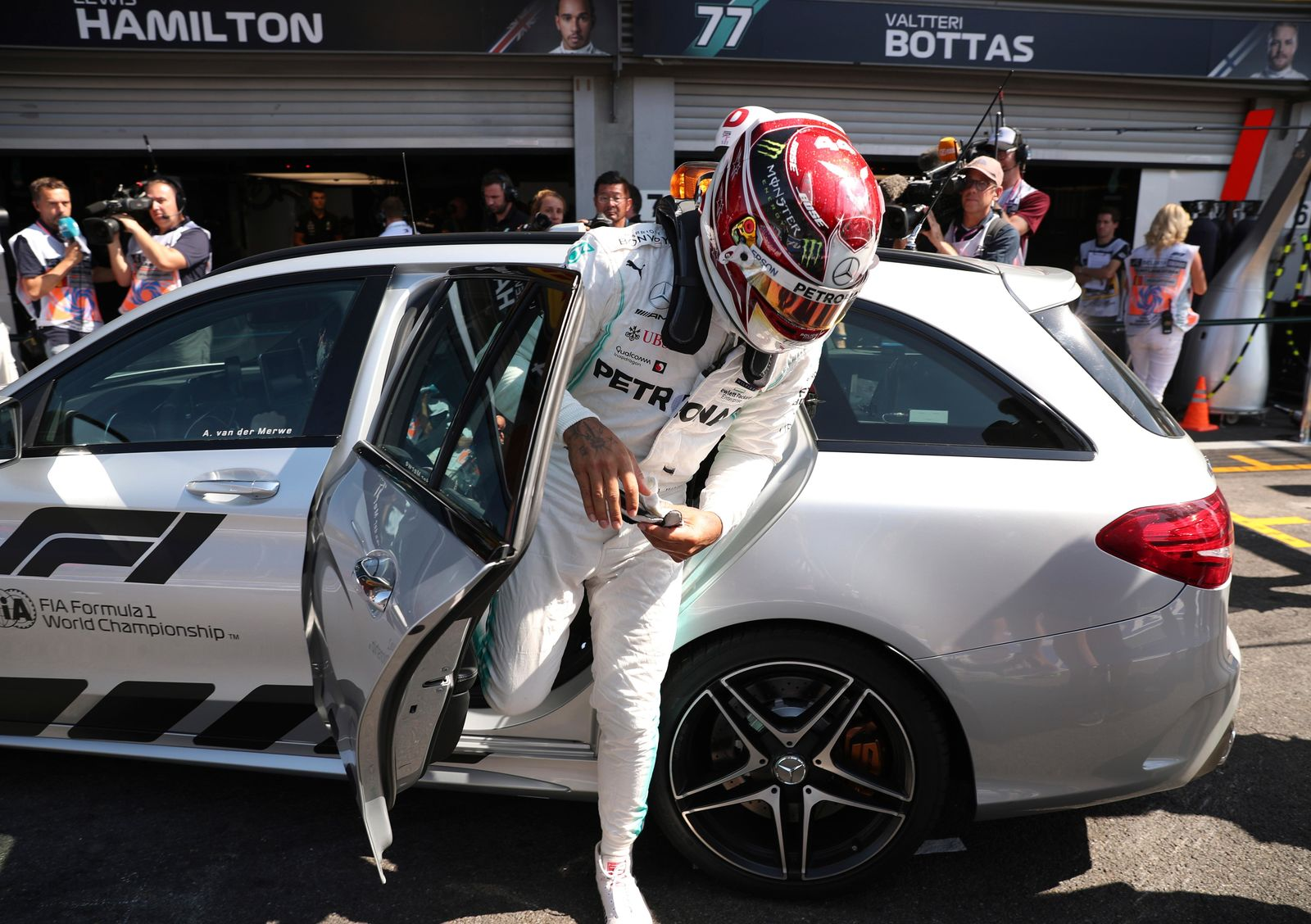 Mercedes driver Lewis Hamilton of Britain gets out of the team car after his car hit a barrier during the third practice session ahead of the Belgian Formula One at Spa-Francorchamps, Belgium, Saturday, Aug. 31, 2019. The Belgian Formula One race will take place on Sunday. (AP Photo/Francisco Seco)