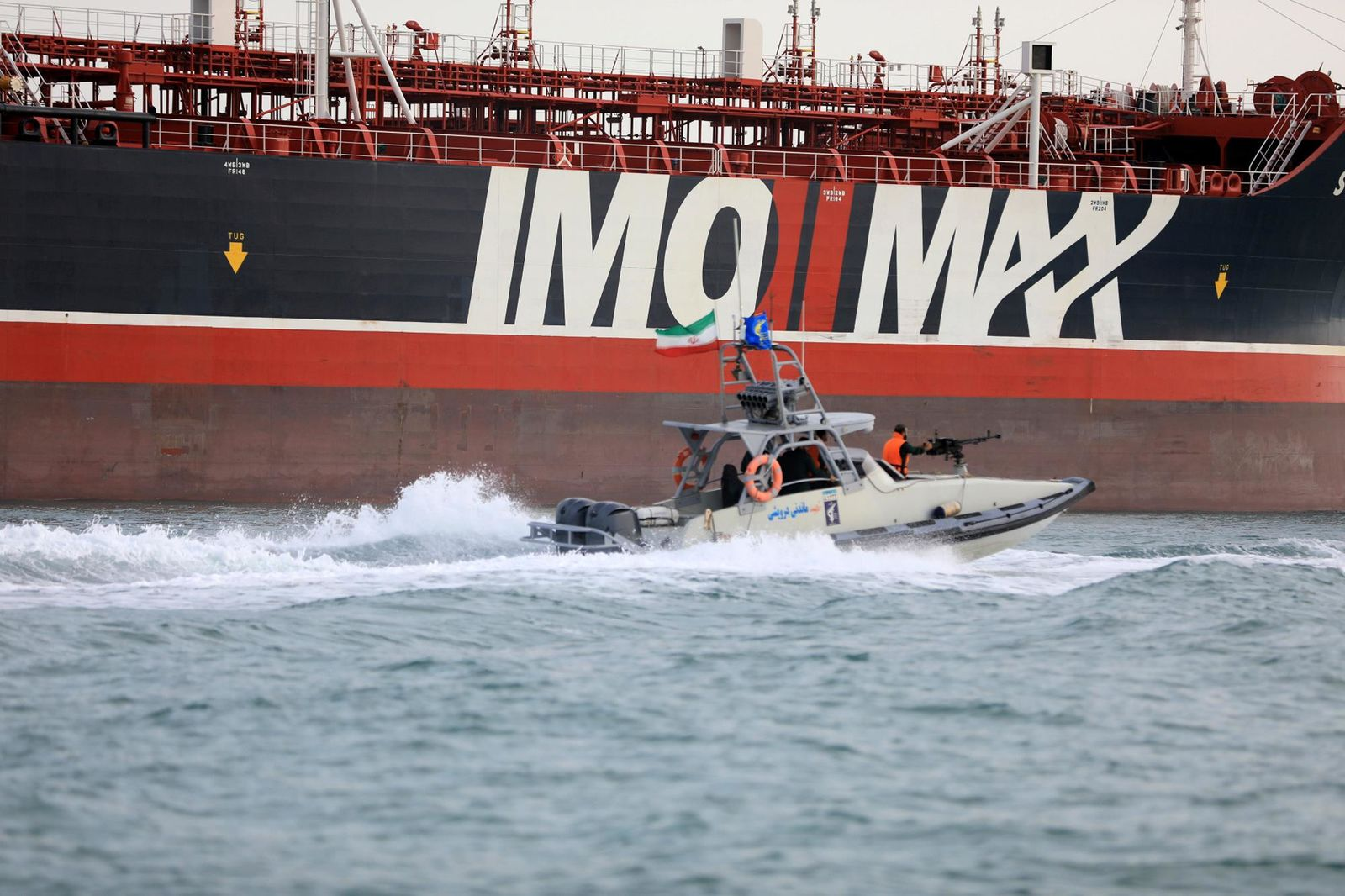 In this Sunday, July 21, 2019 photo, a speedboat of the Iran's Revolutionary Guard moves around a British-flagged oil tanker Stena Impero which was seized in the Strait of Hormuz on Friday by the Guard, in the Iranian port of Bandar Abbas.{ } (Morteza Akhoondi/Mehr News Agency via AP)