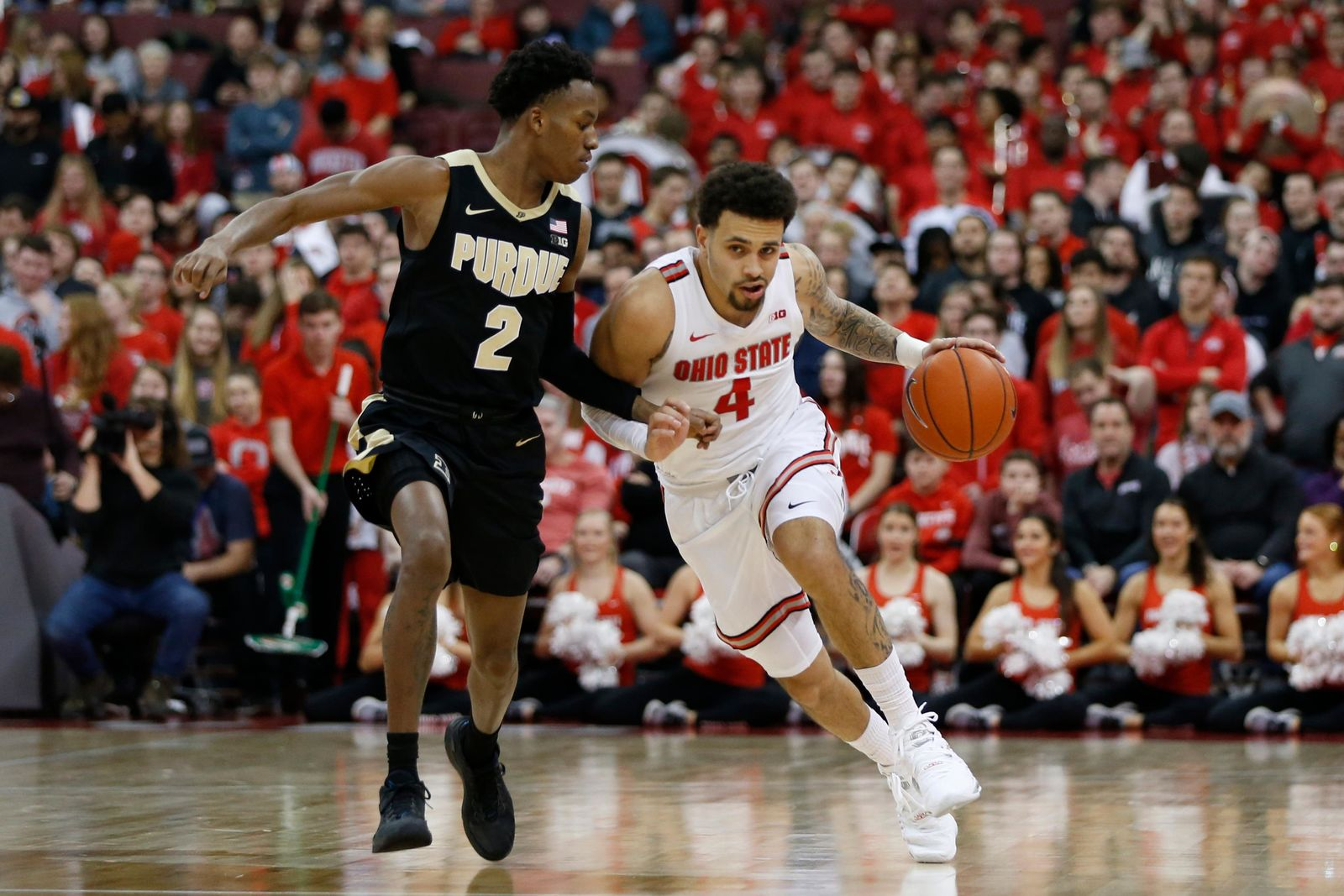 Ohio State's Duane Washington, right, brings the ball up court against Purdue's Eric Hunter during the second half of an NCAA college basketball game Saturday, Feb. 15, 2020, in Columbus, Ohio. Ohio State beat Purdue 68-52. (AP Photo/Jay LaPrete)