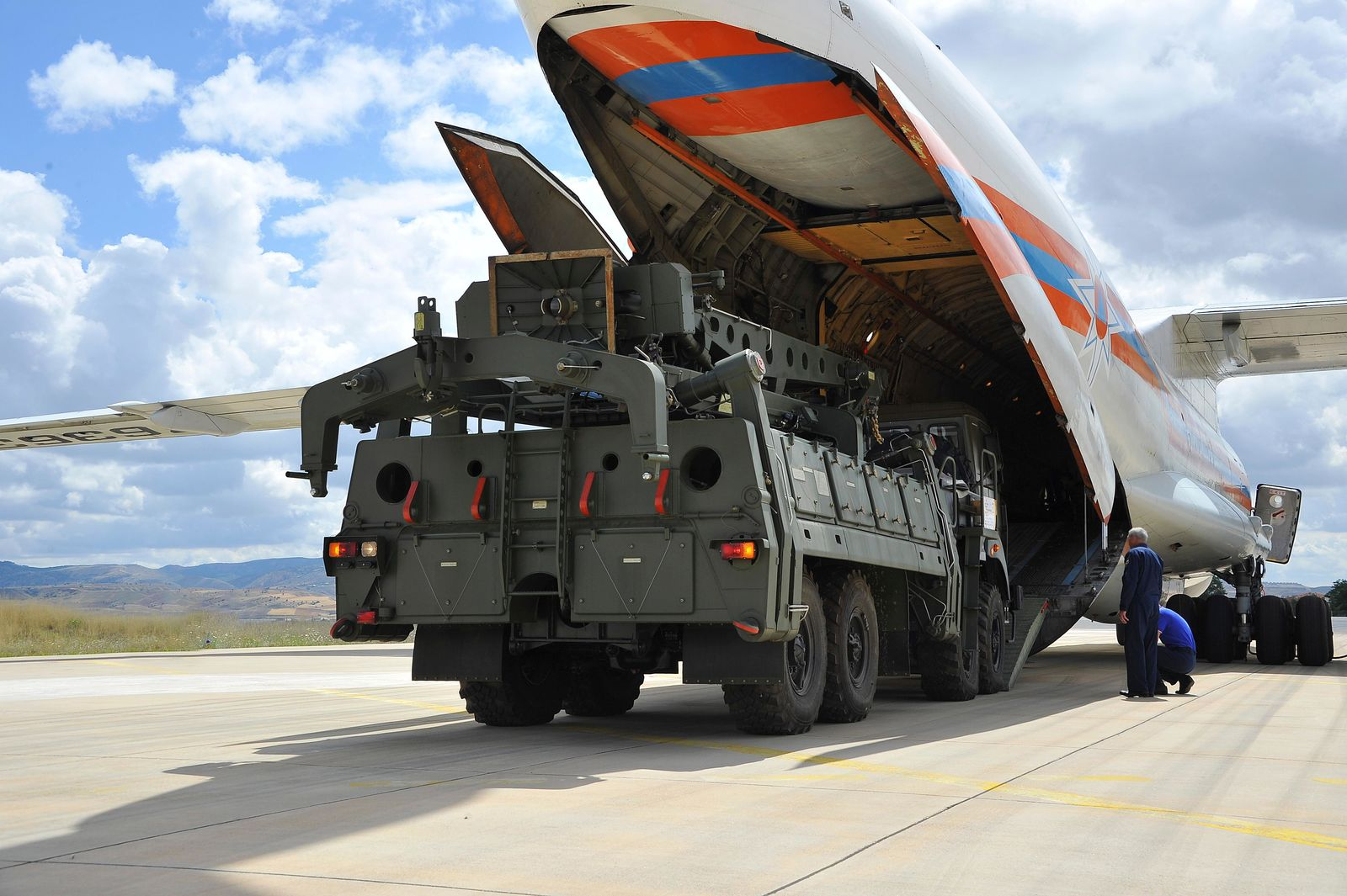 Military vehicles and equipment, parts of the S-400 air defense systems, are unloaded from a Russian transport aircraft, at Murted military airport in Ankara, Turkey, Friday, July 12, 2019. (Turkish Defence Ministry via AP, Pool)