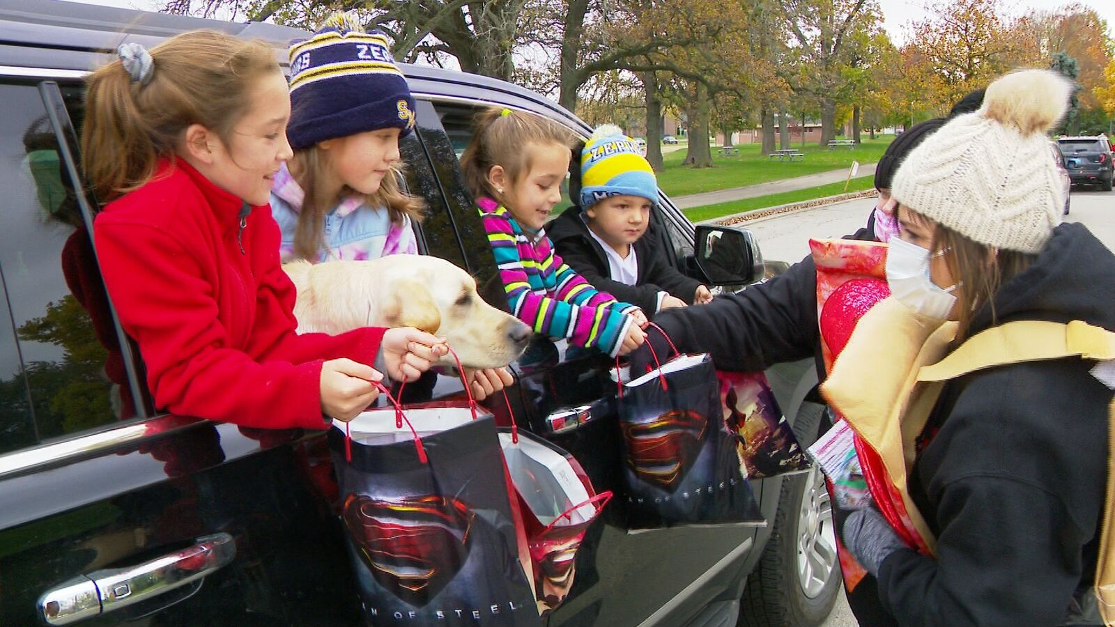 Kids get their bags filled with candy at the Truck or Treat event in Menomonie Park Zoo (courtesy: WLUK)