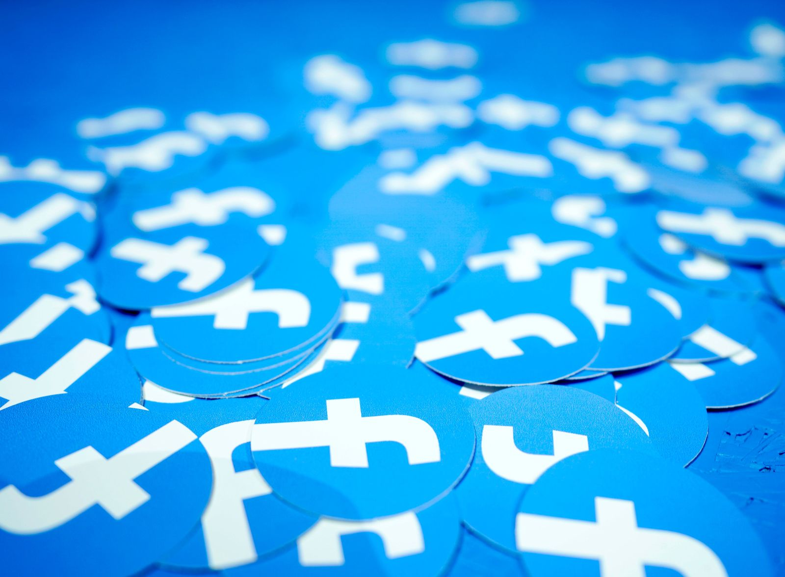 FILE - In this April 30, 2019, file photo, Facebook stickers are laid out on a table at F8, Facebook's developer conference in San Jose, Calif.{ } (AP Photo/Tony Avelar, File)