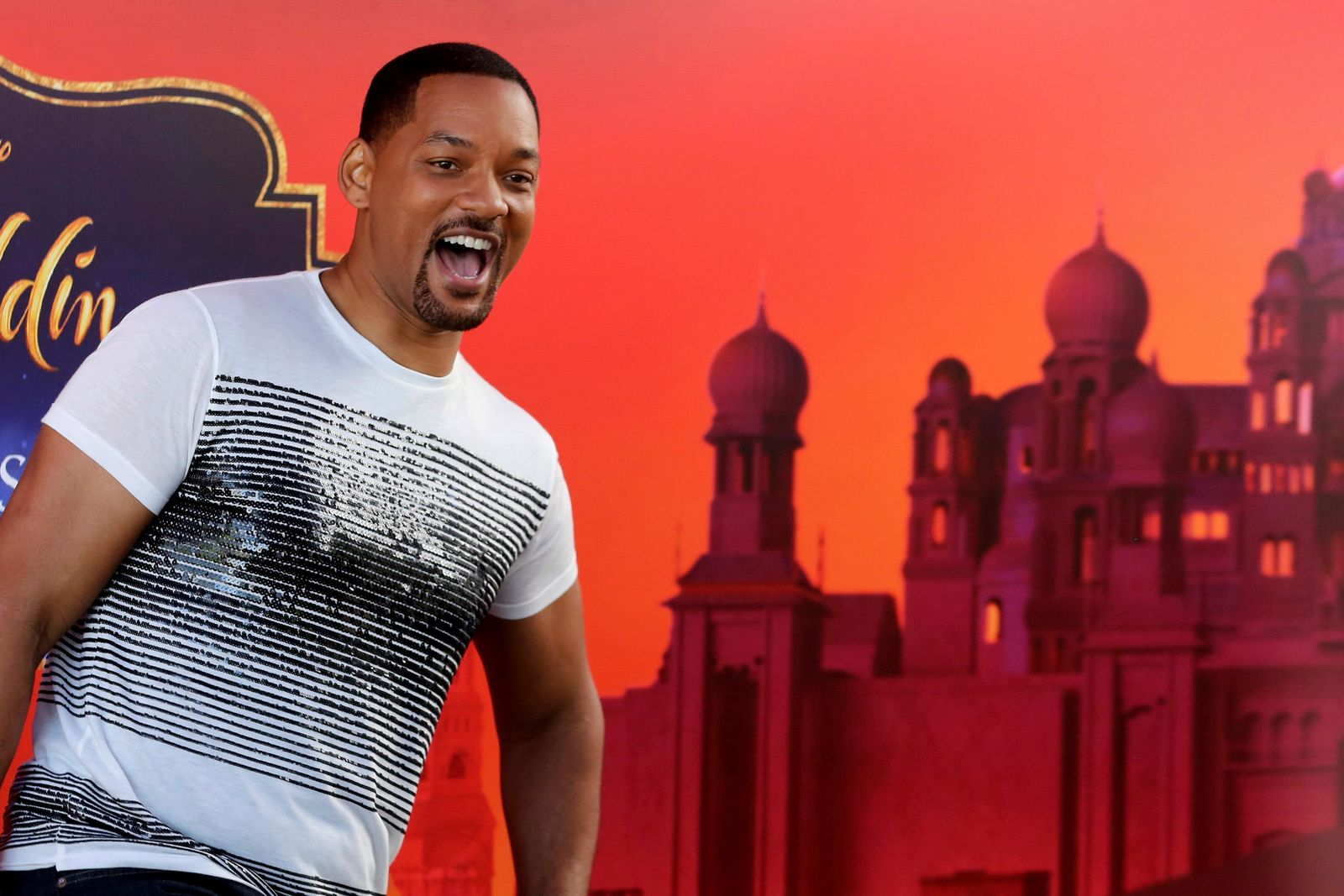 "U.S. actor Will Smith reacts during a news conference with director Guy Ritchie and stars Mena Massoud and Naomi Scott, ahead of the regional launching of Disney's live-action ""Aladdin,"" in the Jordanian capital Amman.{ } (AP Photo/Raad Adayleh)"