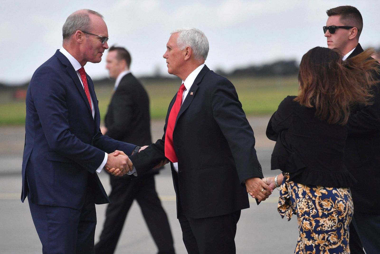 Ireland's Minister of foreign affairs Simon Coveney, left, meets US Vice President Mike Pence as he arrives at Shannon airport for the start of an official visit to Ireland, Monday, Sept. 2, 2019. (Jacob King/PA via AP)