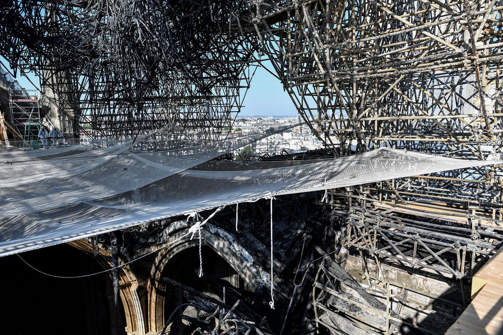 Parts of a destroyed ribbed vault and scaffolding are pictured at the Notre-Dame de Paris Cathedral, Wednesday, July 17, 2019 in Paris. (Stephane de Sakutin/Pool via AP)