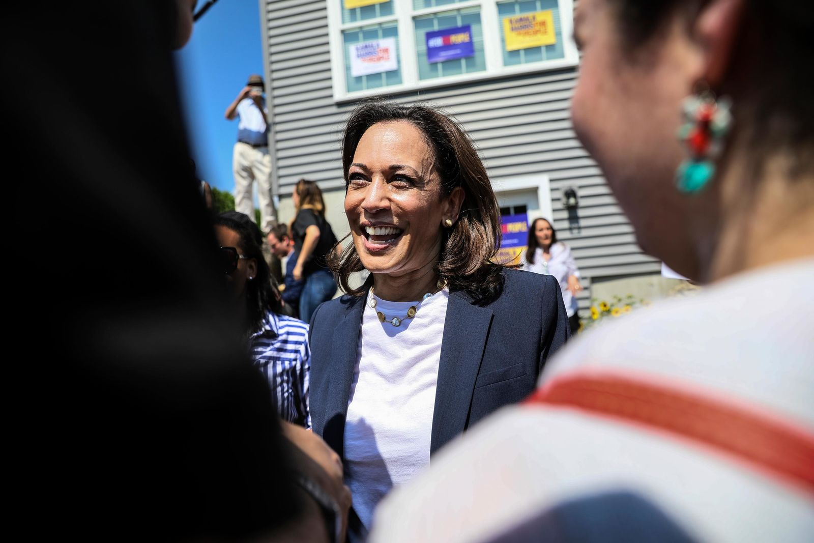 Supporters applaud as Democratic presidential candidate, U.S Sen. Kamala Harris, D-Calif., greets supporters after speaking at a house party in Gilford, N.H., Sunday, July 14, 2019. (AP Photo/ Cheryl Senter)