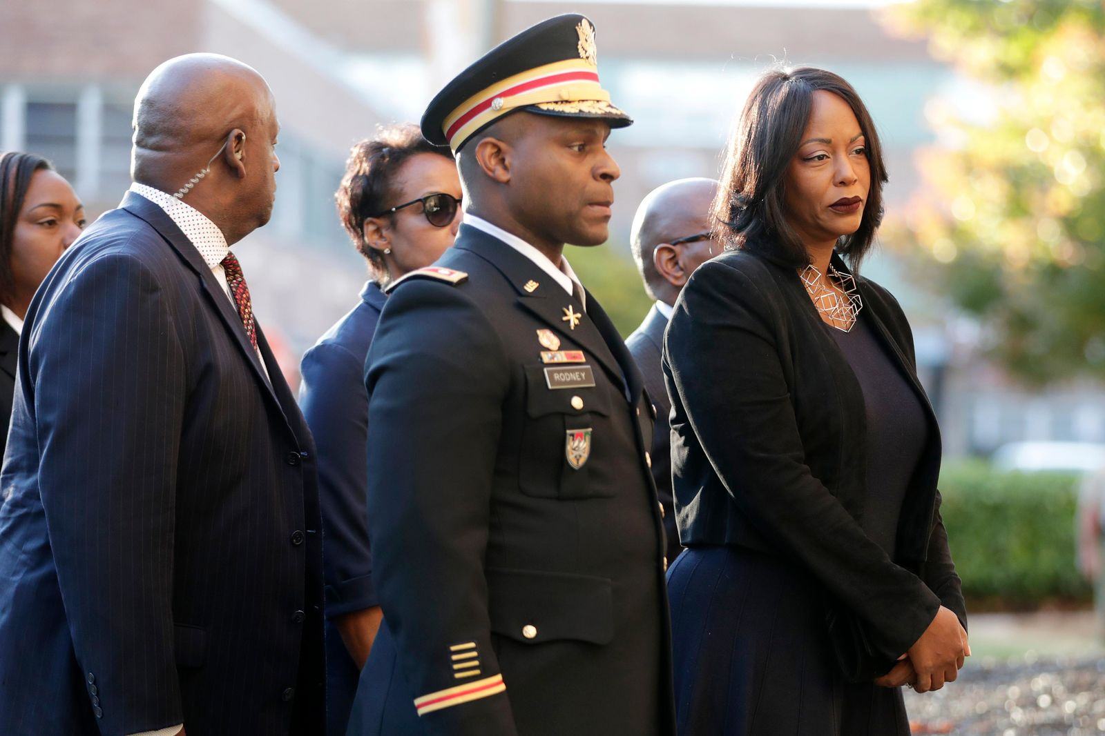 Mourners, including Maya Rockeymoore, right, widow of U.S. Rep. Elijah Cummings follow behind pallbearers walking with the congressman's body while arriving at Morgan State University ahead of a public viewing, Wednesday, Oct. 23, 2019, in Baltimore. (AP Photo/Julio Cortez)