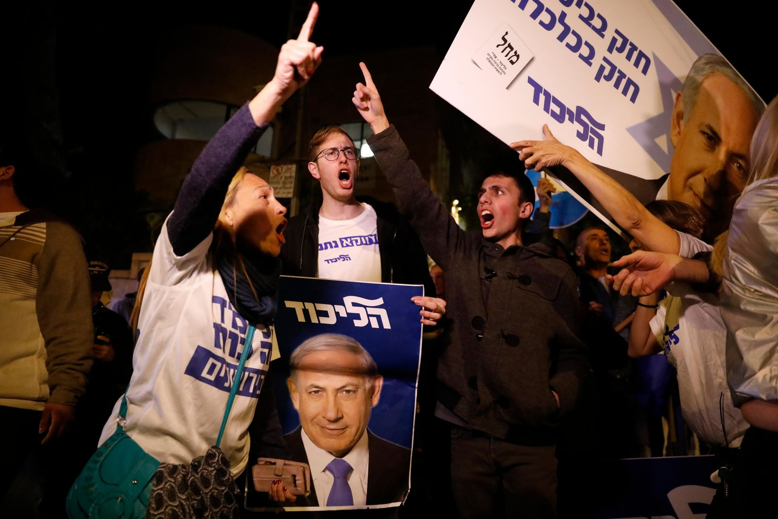 Supporters of Israeli Prime Minister Benjamin Netanyahu gather outside his residence in Jerusalem, Thursday, Nov. 21, 2019. (AP Photo/Ariel Schalit)