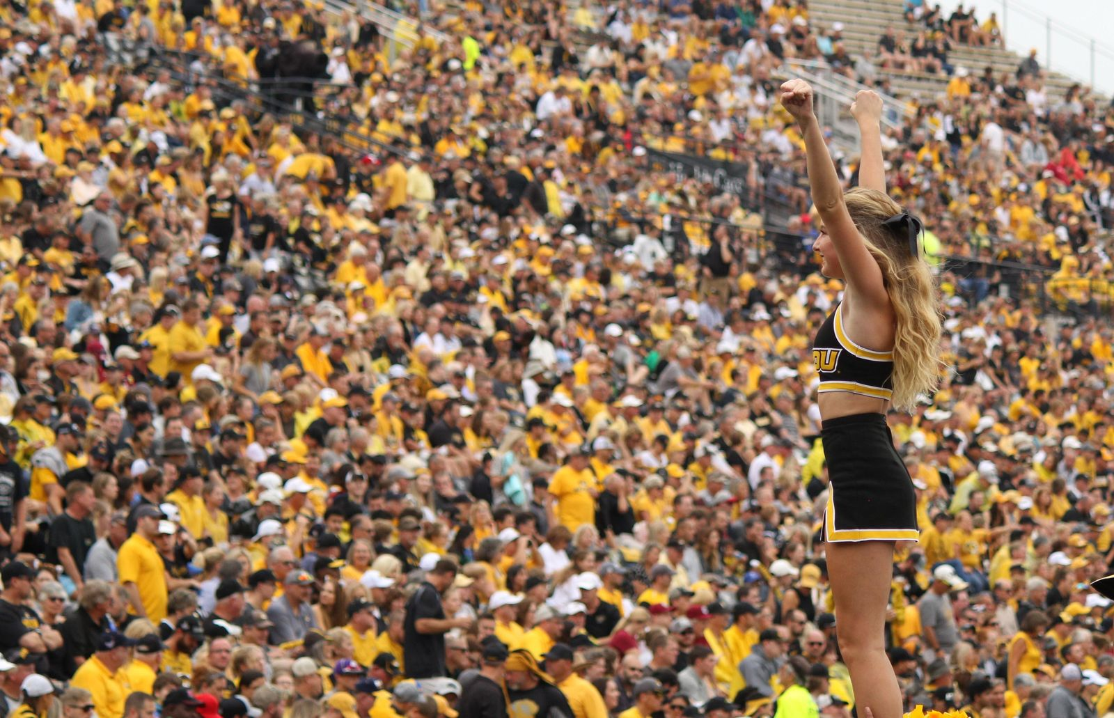 A Mizzou cheerleader stands tall during a celebration{ }Saturday afternoon at Faurot Field in Columbia during the Tigers' 34-14 win over South Carolina. (Noah Brown/KRCG 13)