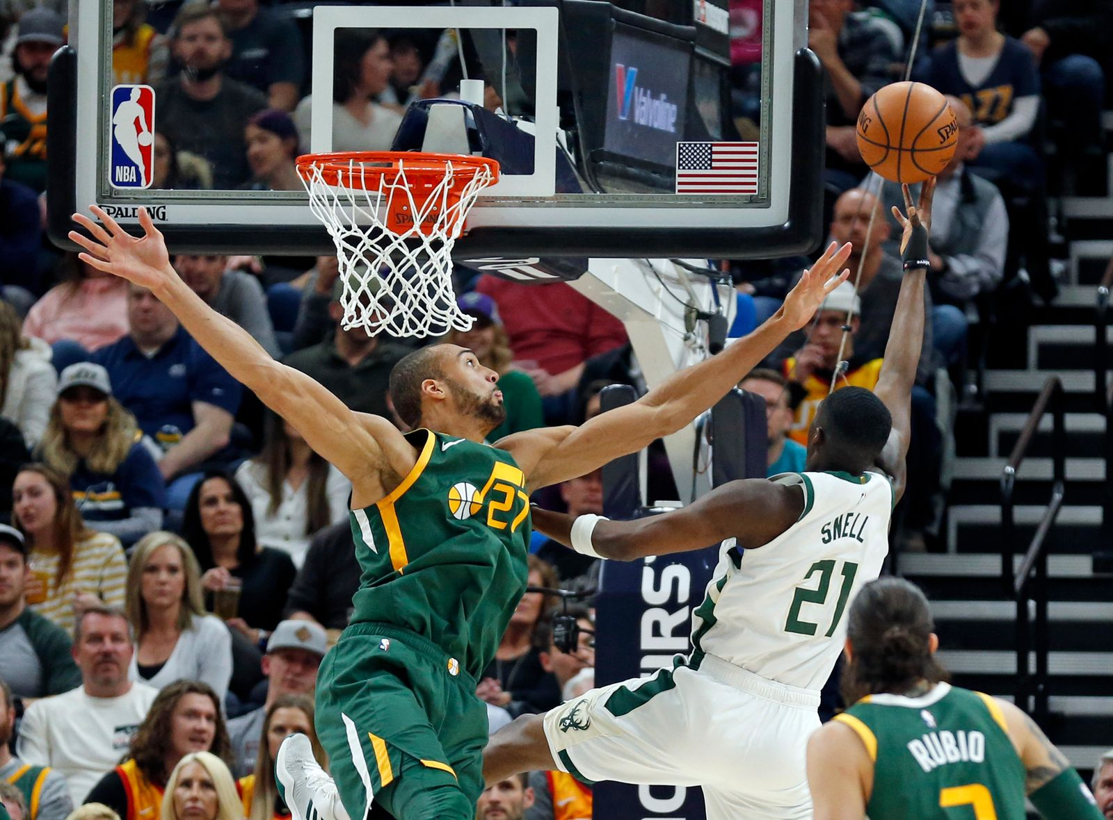 Utah Jazz center Rudy Gobert (27) defends against Milwaukee Bucks guard Tony Snell (21) during the first half of an NBA basketball game Saturday, March 2, 2019, in Salt Lake City. (AP Photo/Rick Bowmer)