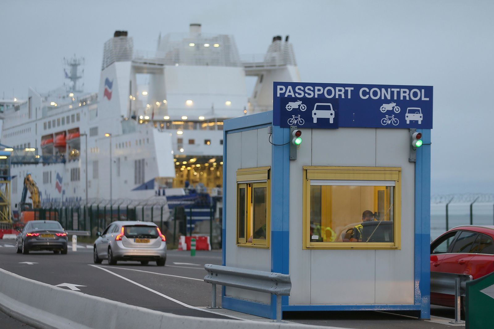 A French custom officer works in a booth at the transit zone at the port of Ouistreham, Normandy, Thursday, Sept.12, 2019. France has trained 600 new customs officers and built extra parking lots arounds its ports to hold vehicles that will have to go through extra checks if there is no agreement ahead of Britain's exit from the EU, currently scheduled on Oct. 31. (AP Photo/David Vincent)