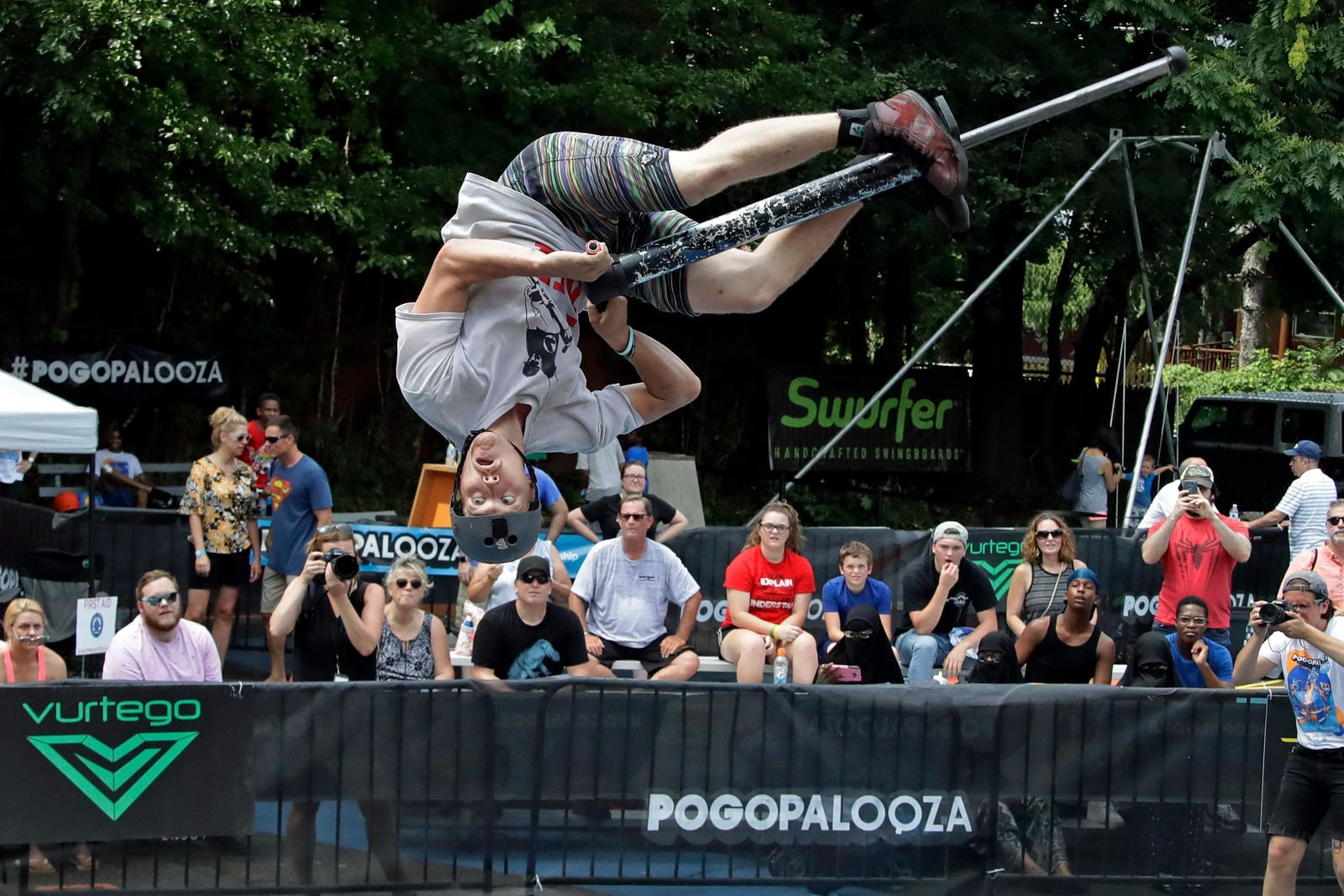 Biff Hutchison, of Burley, Idaho, performs during Pogopalooza, The World Championships of Pogo in Wilkinsburg, Pa., Saturday, July 20, 2019. (AP Photo/Gene J. Puskar)