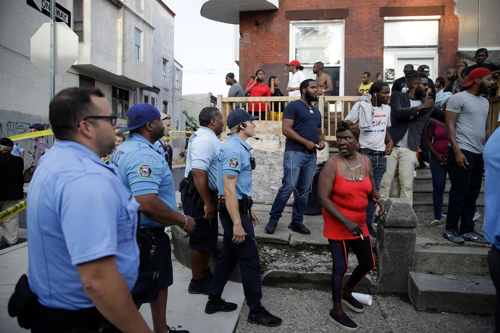 Police urge people to leave the area as they investigate an active shooting situation, Wednesday, Aug. 14, 2019, in the Nicetown neighborhood of Philadelphia. (AP Photo/Matt Rourke)