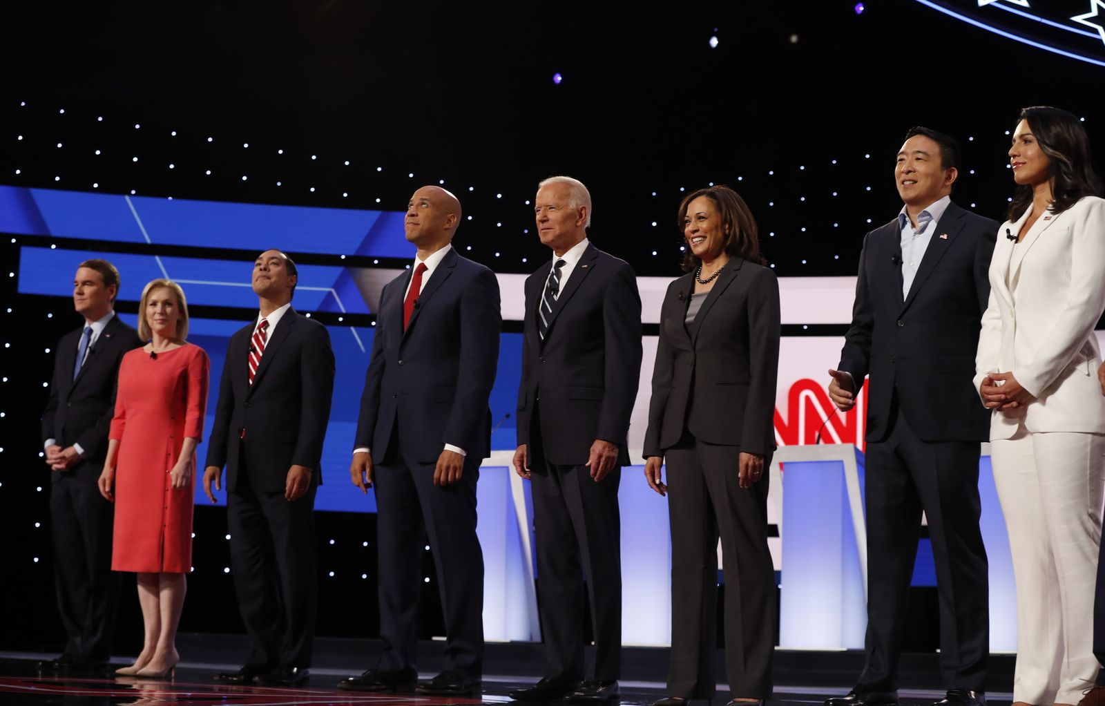 From left, Sen. Michael Bennet, D-Colo., Sen. Kirsten Gillibrand, D-N.Y., former HUD Secretary Julian Castro, Sen. Cory Booker, D-N.J., former Vice President Joe Biden, Sen. Kamala Harris, D-Calif., Andrew Yang and Rep. Tulsi Gabbard, D-Hawaii, are introduced before the second of two Democratic presidential primary debates hosted by CNN Wednesday, July 31, 2019, in the Fox Theatre in Detroit. (AP Photo/Carlos Osorio)