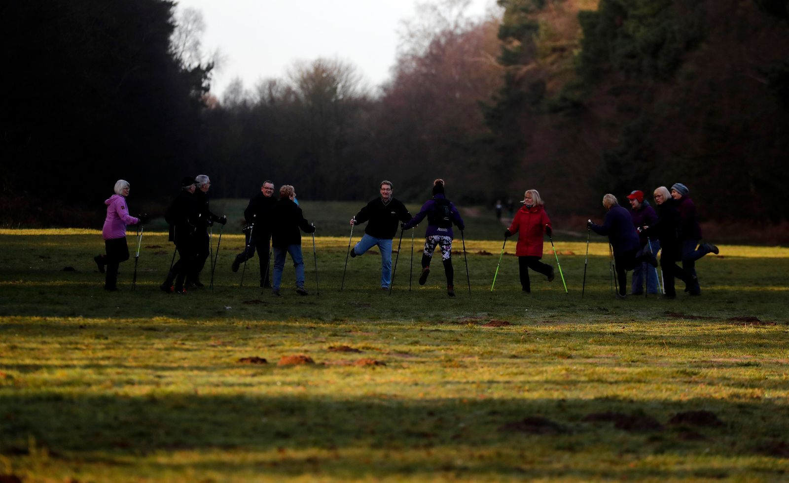 People take part in a morning activity near an entrance of Sandringham estate, Sandringham, England, early morning Monday, Jan. 13, 2020. Britain's Queen Elizabeth II  is preparing for a crisis family meeting to work out a future for Prince Harry and his wife, Meghan, after their dramatic decision to walk away from royal roles. (AP Photo/Frank Augstein)