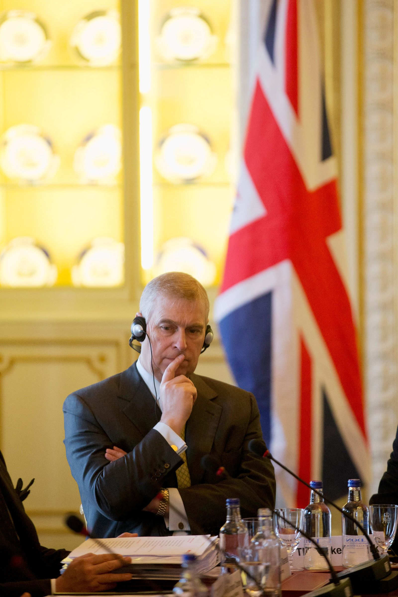 FILE - In this file photo dated Wednesday, March 4, 2015, Britain's Prince Andrew listens as he sits at the top of the table with Mexican President Enrique Pena Nieto and various political leaders during a business breakfast meeting at Buckingham Palace in London. (AP Photo/Matt Dunham, FILE)