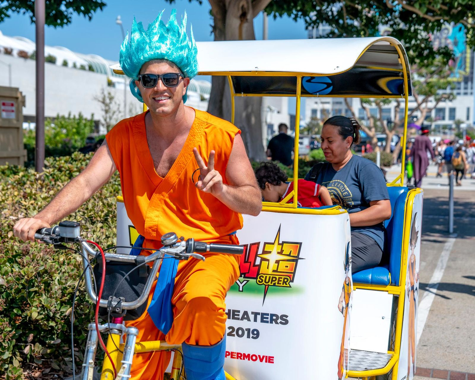 "In this July 20, 2018 file photo, a pedicab driver dressed as a character from the anime franchise ""Dragon Ball"" gestures as he carries passengers during Comic-Con International in San Diego.(Photo by Christy Radecic/Invision/AP, File)"