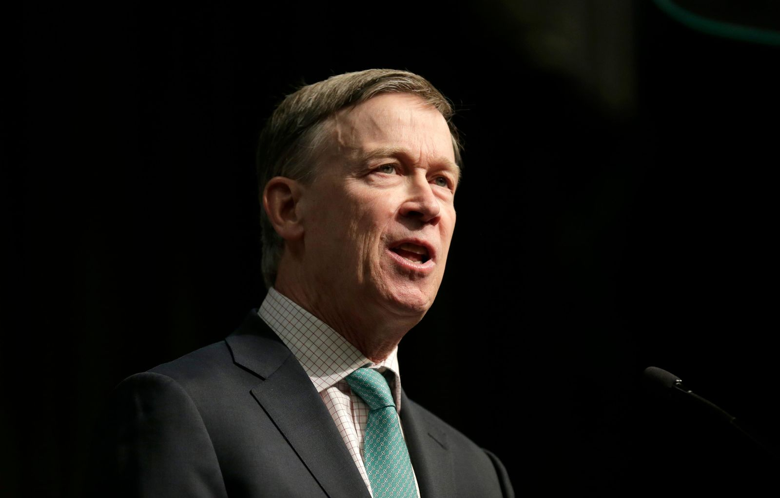 Former Colorado Gov. John Hickenlooper, a candidate for the 2020 Democratic presidential nomination, addresses the National Action Network Convention in New York, Friday, April 5, 2019. (AP Photo/Seth Wenig)
