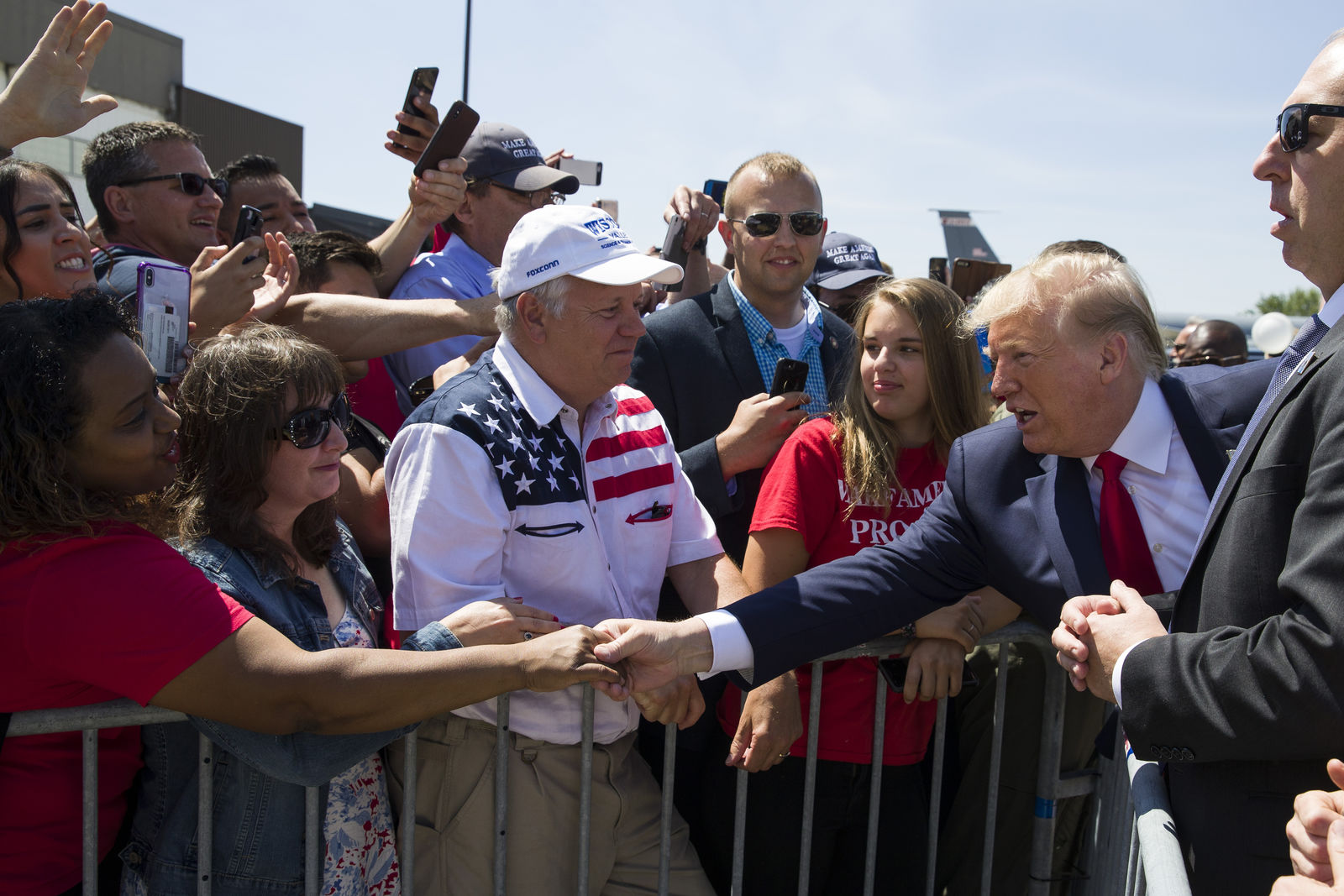 President Donald Trump greets supporters as he arrives at General Mitchell International Airport, Friday, July 12, 2019, in Milwaukee. (AP Photo/Alex Brandon)