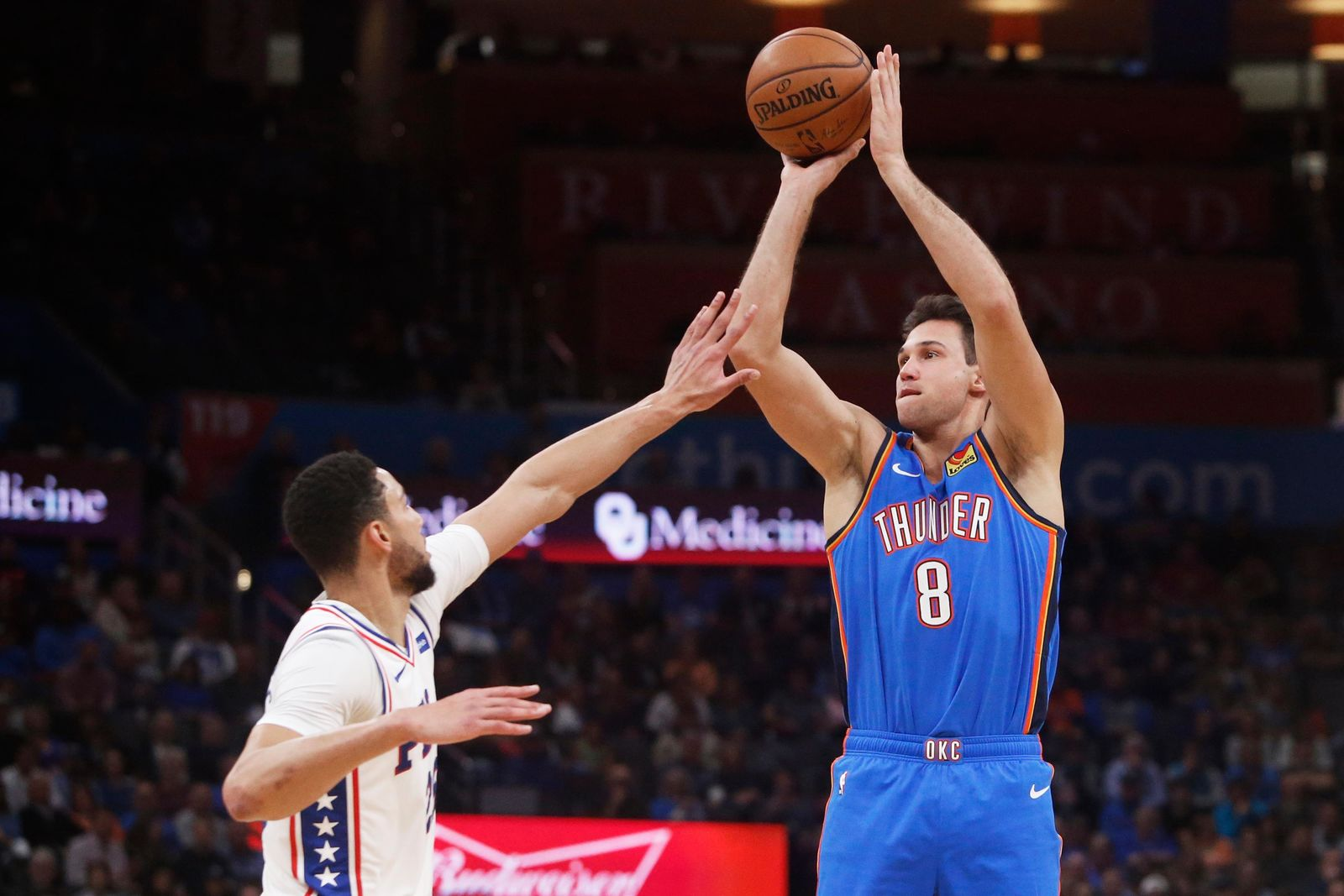 Oklahoma City Thunder forward Danilo Gallinari (8) shoots over Philadelphia 76ers guard Ben Simmons, left, during the first half of an NBA basketball game Friday, Nov. 15, 2019, in Oklahoma City. (AP Photo/Sue Ogrocki)