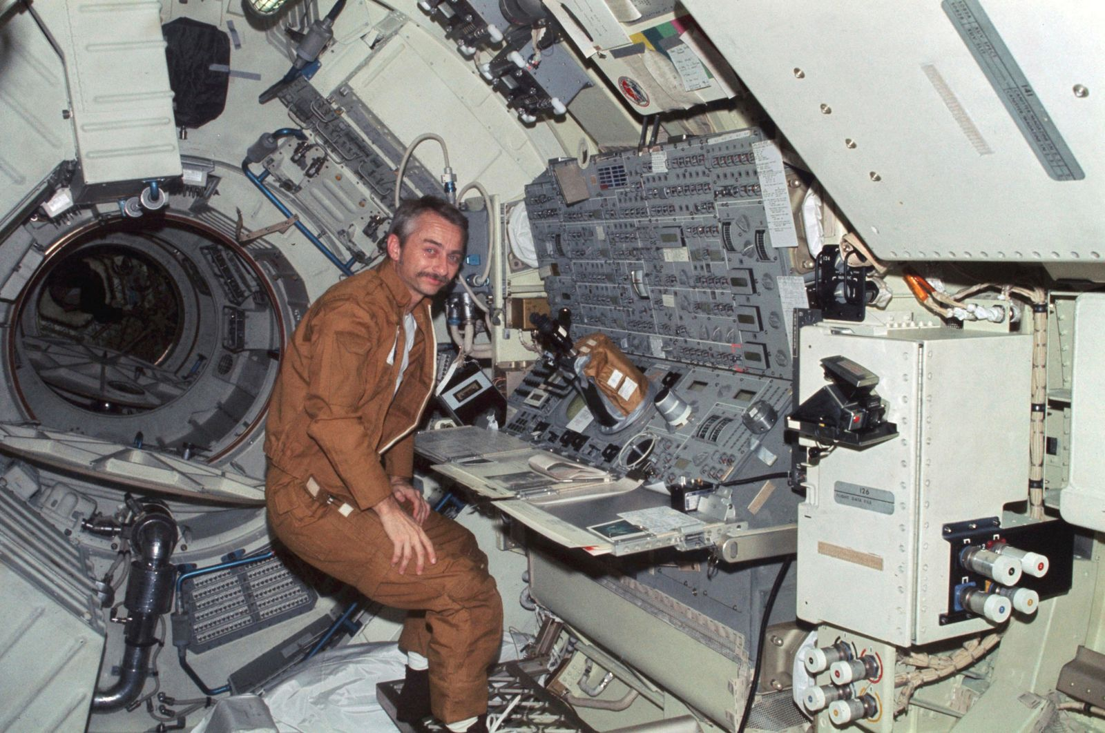 In this 1973 photo made available by NASA, astronaut Owen K. Garriott floats in front of the Apollo Telescope Mount console in the Multiple Docking Adapter of the Skylab space station in Earth orbit.{ } (NASA via AP)