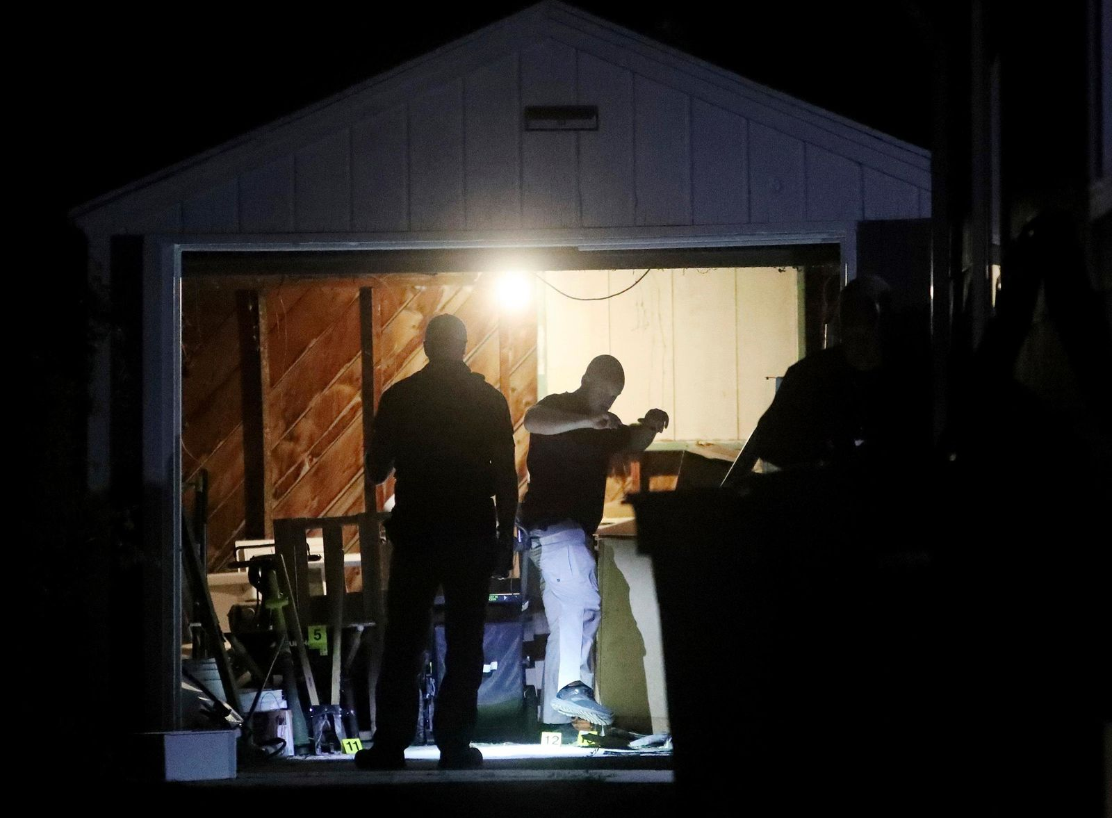 Salt Lake City Police search a home in connection to the disappearance of University of Utah Student Mackenzie Lueck on Wednesday, June 26, 2019, in Salt Lake City. Salt Lake City Assistant Police Chief Tim Doubt said Wednesday night that detectives were serving a search warrant at the home in relation to the case, but refused to provide any more details. (Scott G Winterton/The Deseret News via AP)