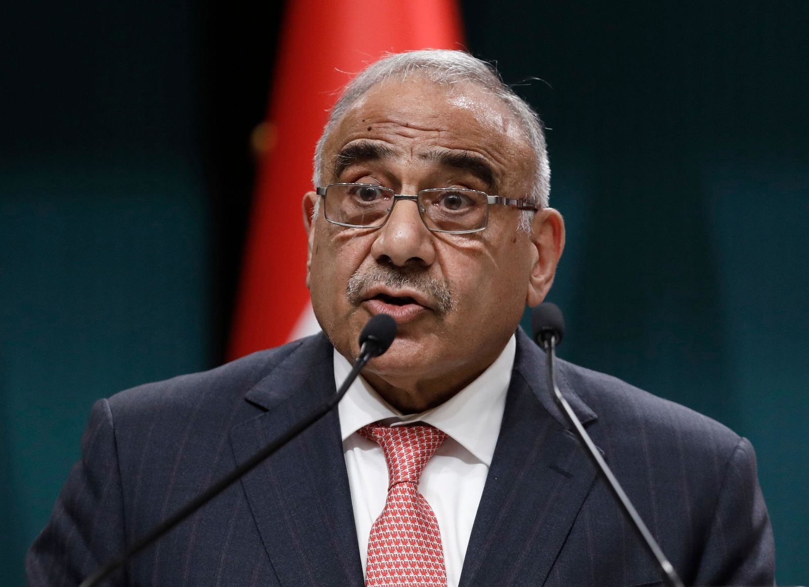 "FILE - In this May 15, 2019 file photo, Iraqi Prime Minister Adel Abdul-Mahdi speaks to the media during a joint news conference with Turkish President Recep Tayyip Erdogan, in Ankara, Turkey.  Adel Abdul-Mahdi said Friday, Nov. 29,  he would submit his resignation to parliament, a day after more than 40 people were killed by security forces and following calls by Iraq's top Shiite cleric for lawmakers to withdraw support. In a statement, Abdul-Mahdi said he ""listened with great concern"" to al-Sistani's sermon and made his decision in response to his call and in order to ""facilitate and hasten its fulfillment as soon as possible.""(AP Photo/Burhan Ozbilici, File)"