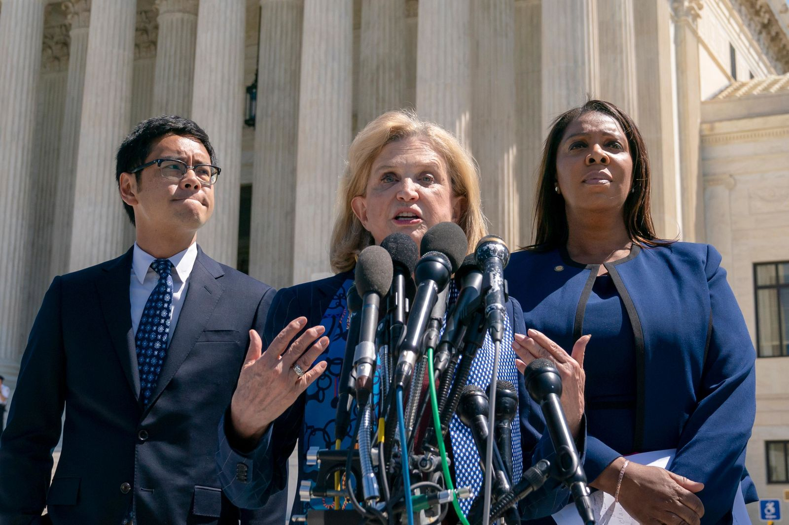 Rep. Carolyn Maloney, D-N.Y., center, joined from left by Dale Ho, attorney for the American Civil Liberties Union, and New York State Attorney General Letitia James, speaks to reporters after the Supreme Court heard arguments over the Trump administration's plan to ask about citizenship on the 2020 census, in Washington, Tuesday, April 23, 2019.{ } (AP Photo/J. Scott Applewhite)