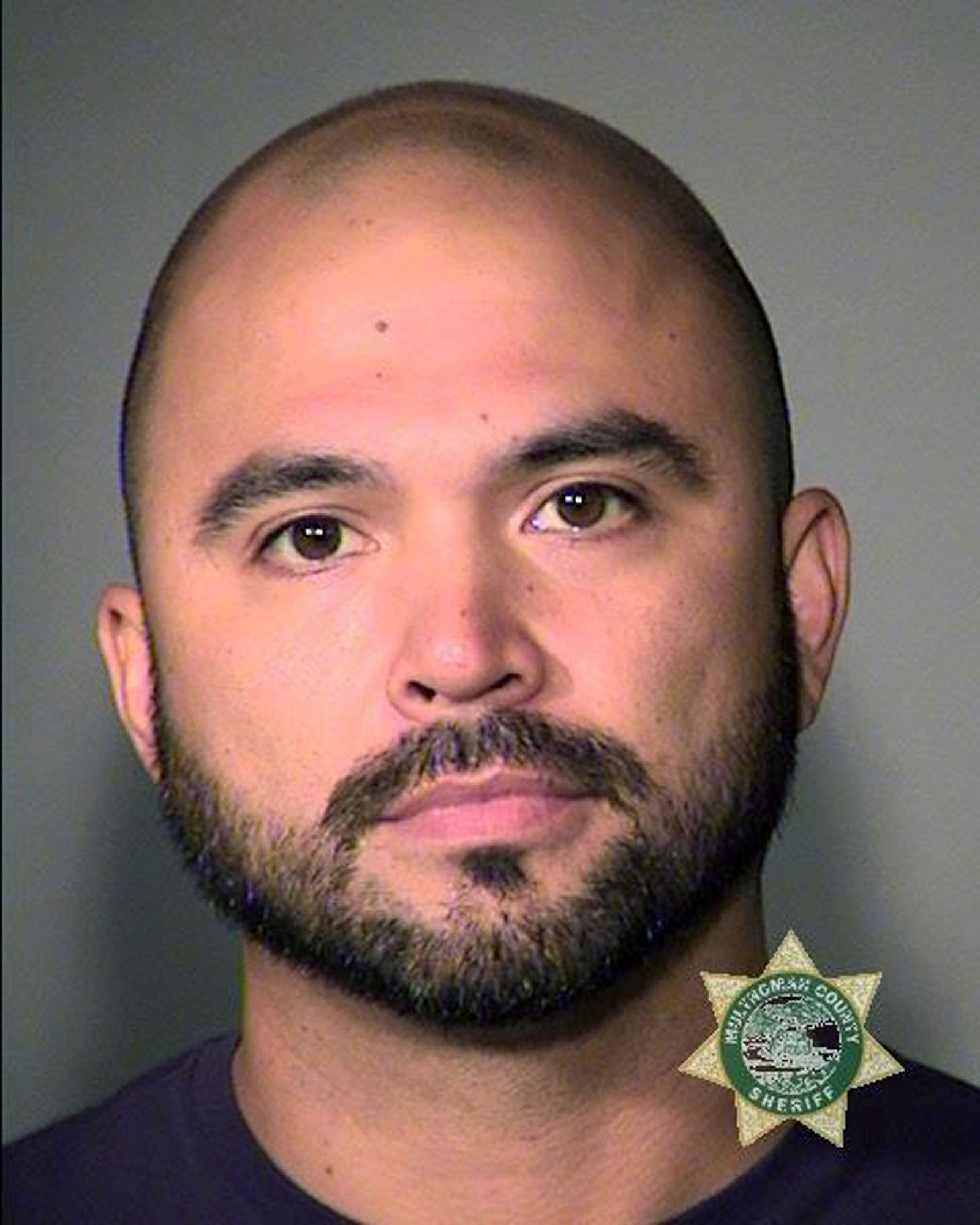 "This booking photo provided by the Multnomah County Sheriff's Office shows Patriot Prayer leader Joey Gibson on Friday, Aug. 16, 2019. Authorities arrested Gibson, the leader of the right-wing group, on the eve of a far-right rally that's expected to draw people from around the U.S. to Portland, Ore., on Saturday, Aug. 17 prompting Gibson to urge his followers to ""show up one hundred-fold"" in response. (Multnomah County Sheriff's Office via AP)"