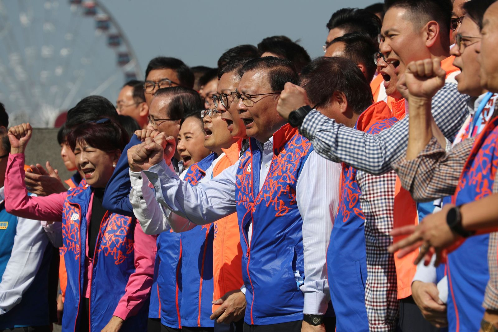 In this photo taken Thursday, Nov. 21, 2019, Members of the pro-government Democratic Alliance for the Betterment and Progress of Hong Kong, gestures during an event ahead of the upcoming district elections held in Hong Kong in Hong Kong. AP Photo/Ng Han Guan)