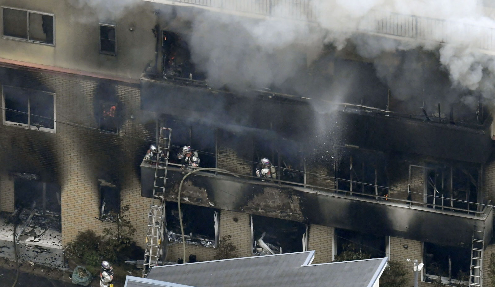 Smoke billows from a Kyoto Animation buildin in Kyoto, western Japan, Thursday, July 18, 2019. The fire broke out in the three-story building in Japan's ancient capital of Kyoto, after a suspect sprayed an unidentified liquid to accelerate the blaze, Kyoto prefectural police and fire department officials said.(Kyodo News via AP)