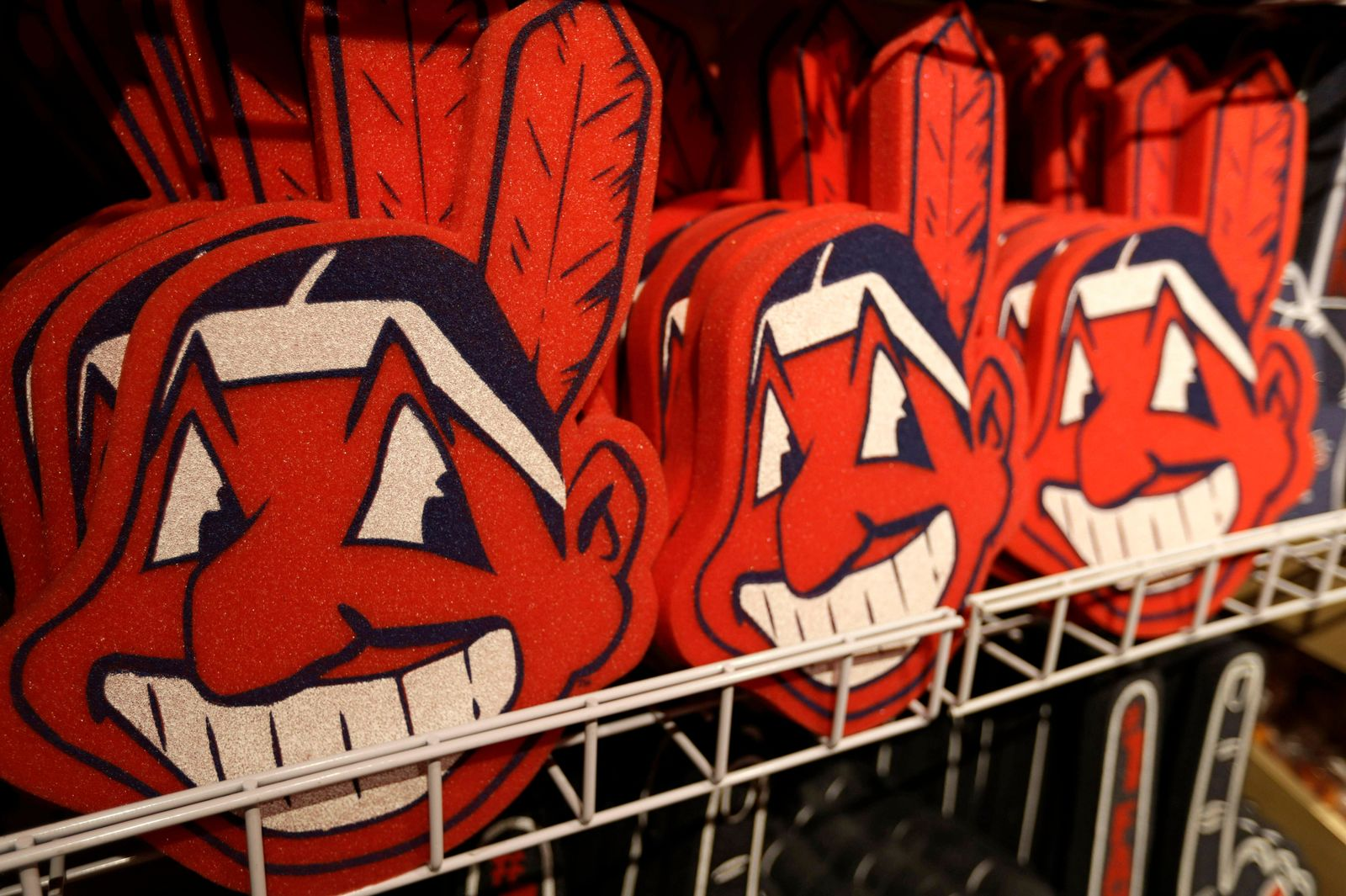 FILE - In this Jan. 29, 2018, file photo, foam images of the Cleveland Indians baseball team mascot Chief Wahoo are displayed for sale at the Indians' team shop in Cleveland. While Major League Baseball and the Indians mutually agreed in 2018 to completely remove him from the team's jerseys and caps as well as banners and signage in the ballpark starting this season, Chief Wahoo appears to be as visible as ever. (AP Photo/Tony Dejak, File)