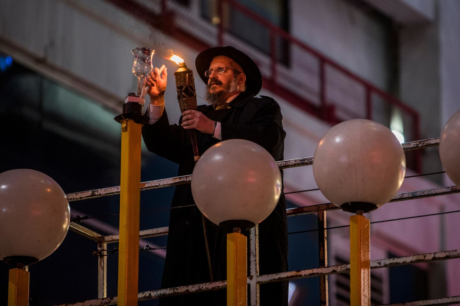 Rabbi Shea Harlig lights the Grand Menorah in downtown Las Vegas on Sunday, Dec. 2. The Grand Menorah will remain on display throughout the Hanukkah season. CREDIT: Joe Buglewicz/Las Vegas News Bureau