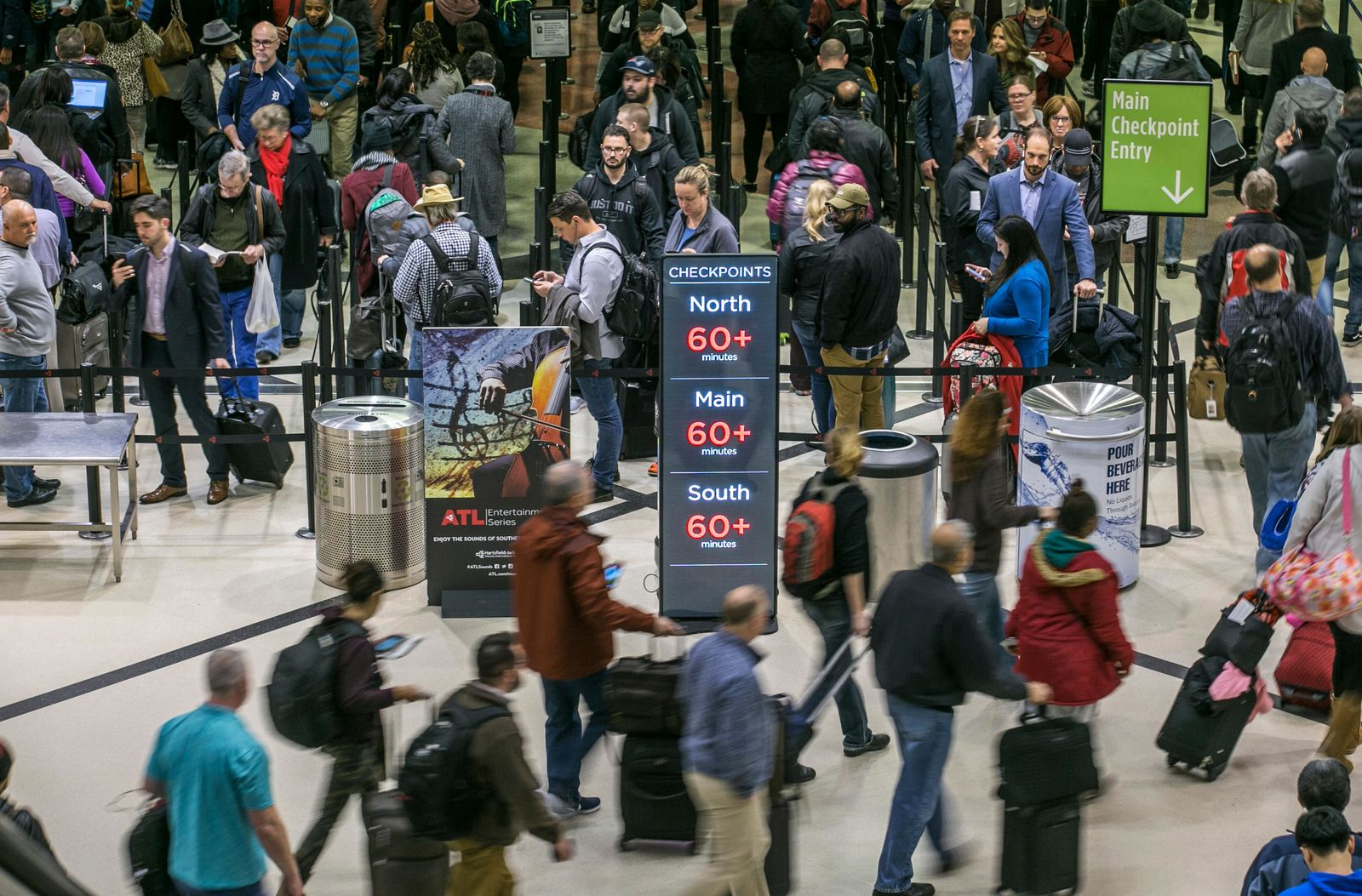 Security lines at Hartsfield-Jackson International Airport in Atlanta stretch more than an hour long amid the partial federal shutdown, causing some travelers to miss flights. (John Spink/Atlanta Journal-Constitution via AP)