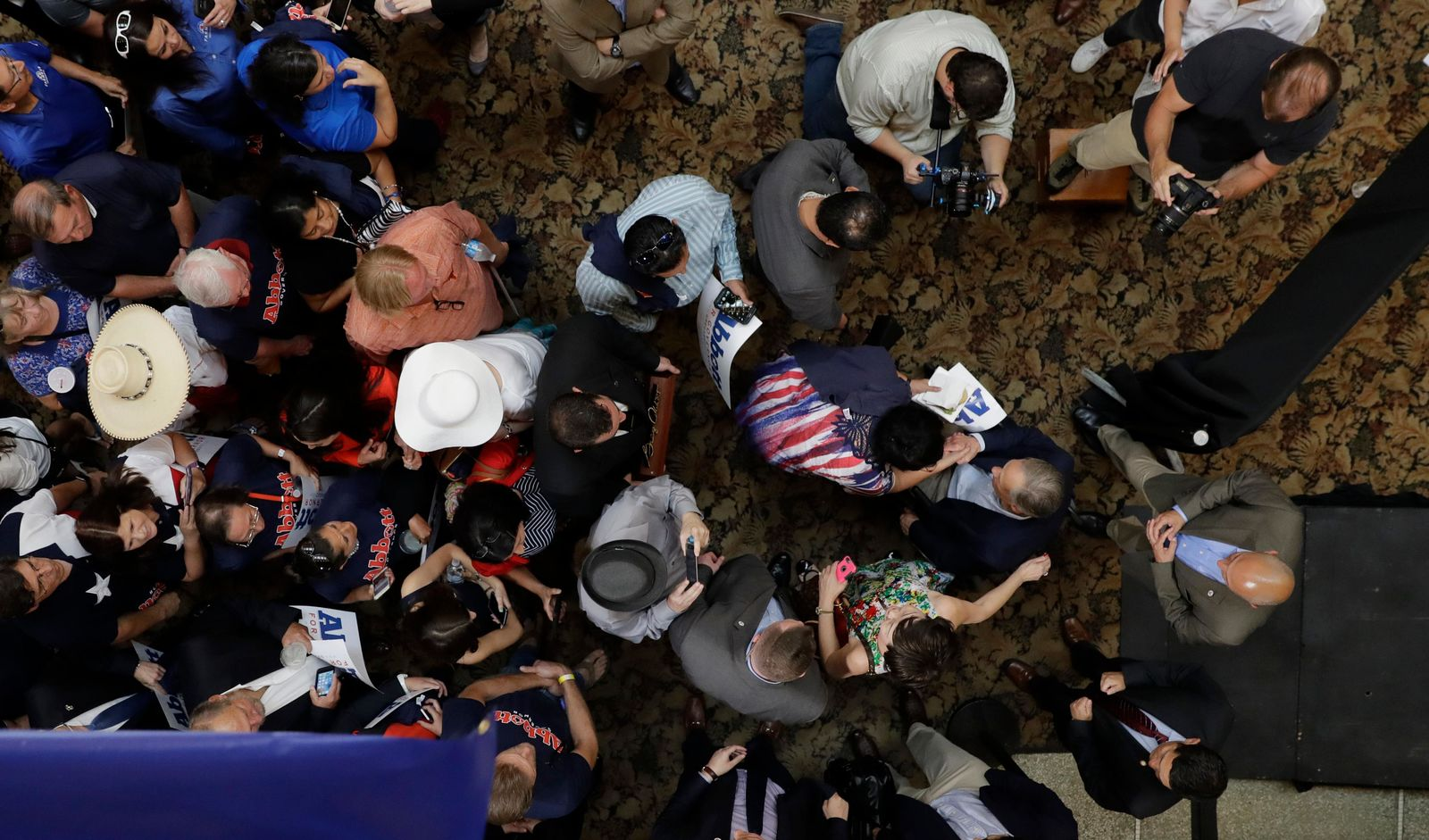 Texas Gov. Greg Abbott, right center, greets supporters during an event where he announced his bid for re-election, Friday, July 14, 2017, in San Antonio. (AP Photo/Eric Gay)