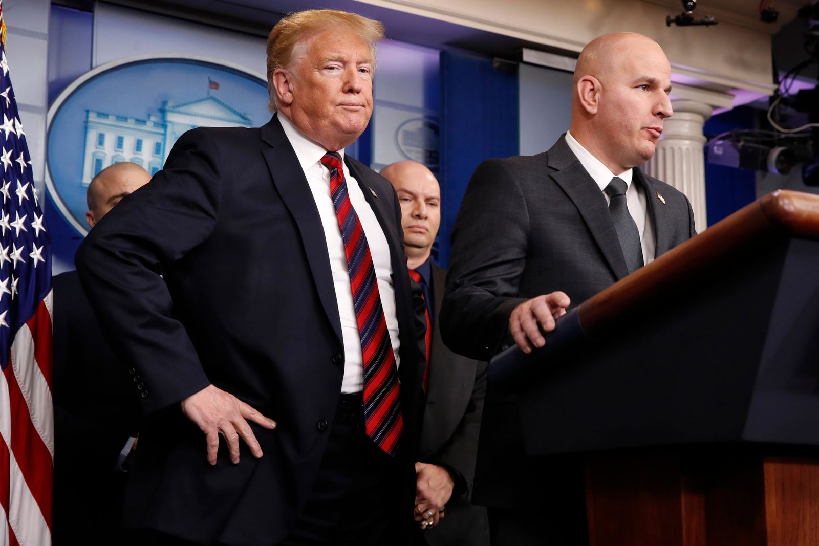 FILE - In this Jan. 3, 2019, file photo, President Donald Trump, left, listens as Brandon Judd, president of the National Border Patrol Council, talks about border security after making a surprise visit to the press briefing room of the White House in Washington. (AP Photo/Jacquelyn Martin, File)