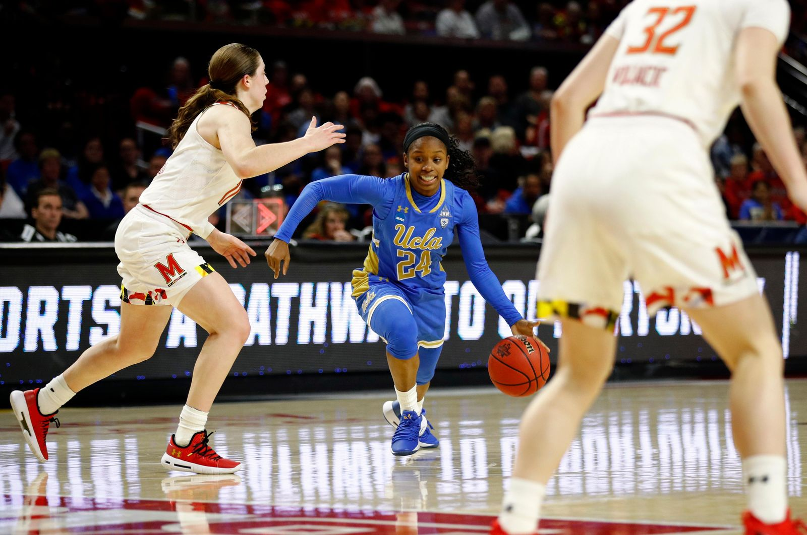 UCLA guard Japreece Dean, center, drives against Maryland guards Taylor Mikesell, left, and Sara Vujacic (32) during the first half of a second-round game in the NCAA women's college basketball tournament Monday, March 25, 2019, in College Park, Md. (AP Photo/Patrick Semansky)
