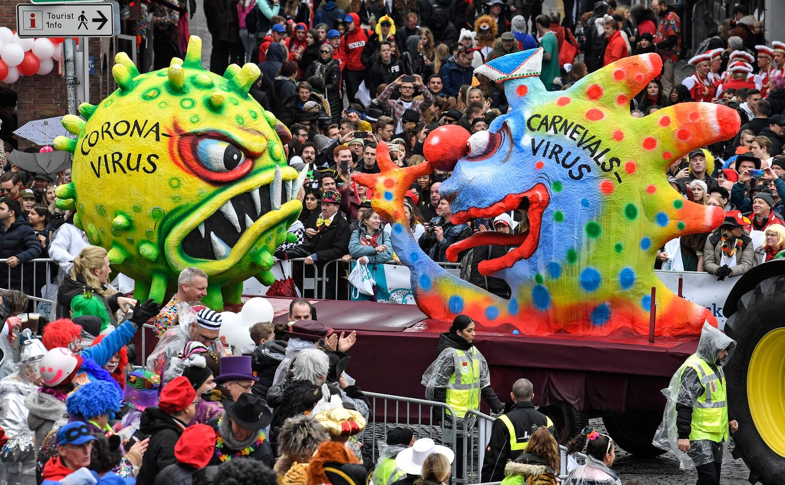 A carnival float depicts a carnival virus laughing at a corona virus during the traditional carnival parade in Duesseldorf, Germany, on Monday, Feb. 24, 2020. The foolish street spectacles in the carnival centers of Duesseldorf, Mainz and Cologne, watched by hundreds of thousands of people, are the highlights in Germany's carnival season on Rosemonday. (AP Photo/Martin Meissner)