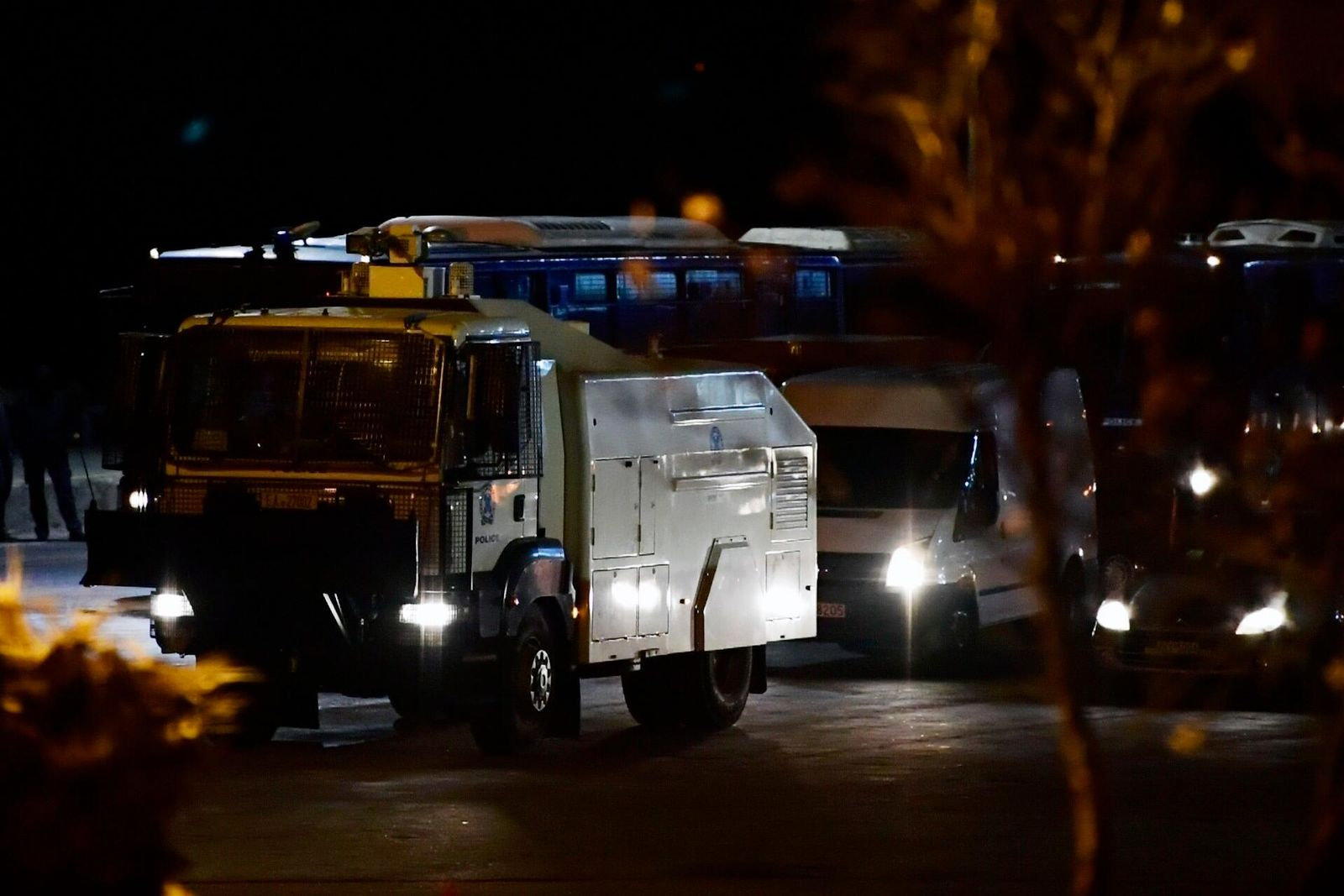 A police water cannon and other police vehicles arrive at the port of Mytilene on the northeastern Aegean island of Lesbos, Greece, early Tuesday, Feb. 25, 2020. (AP Photo/Michael Varaklas)