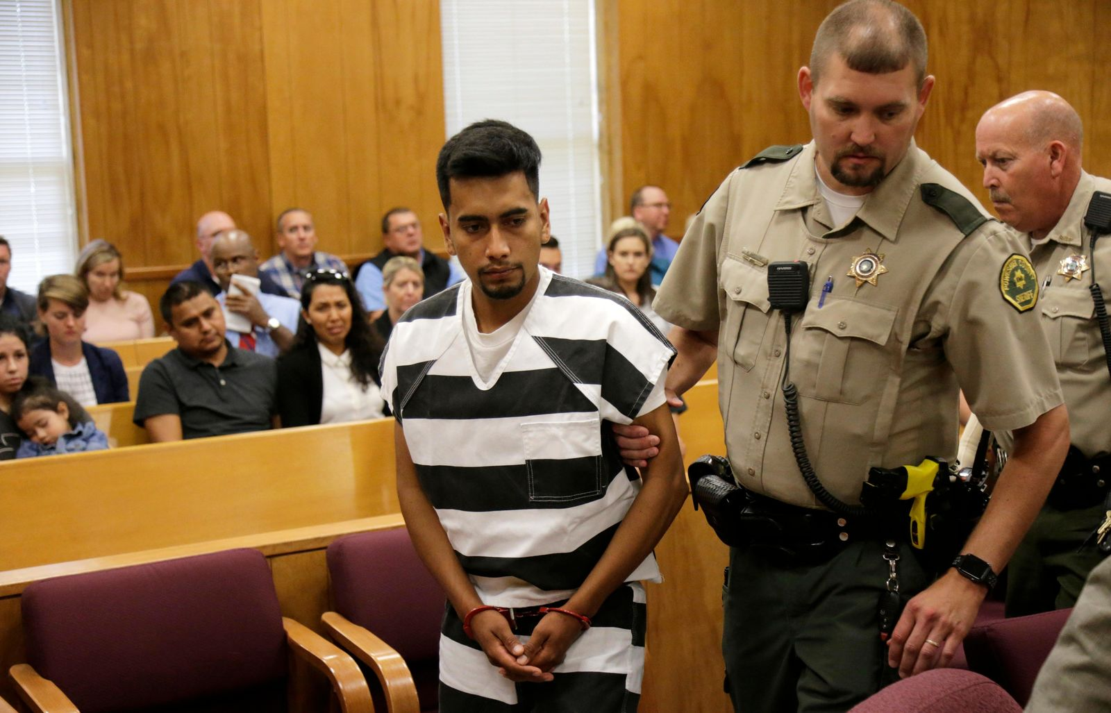 FILE - Cristhian Bahena Rivera is lead into the courtroom for his initial court appearance, Wednesday, Aug. 22, 2018, at the Poweshiek County Courthouse in Montezuma, Iowa. (Jim Slosiarek/The Gazette via AP, Pool)