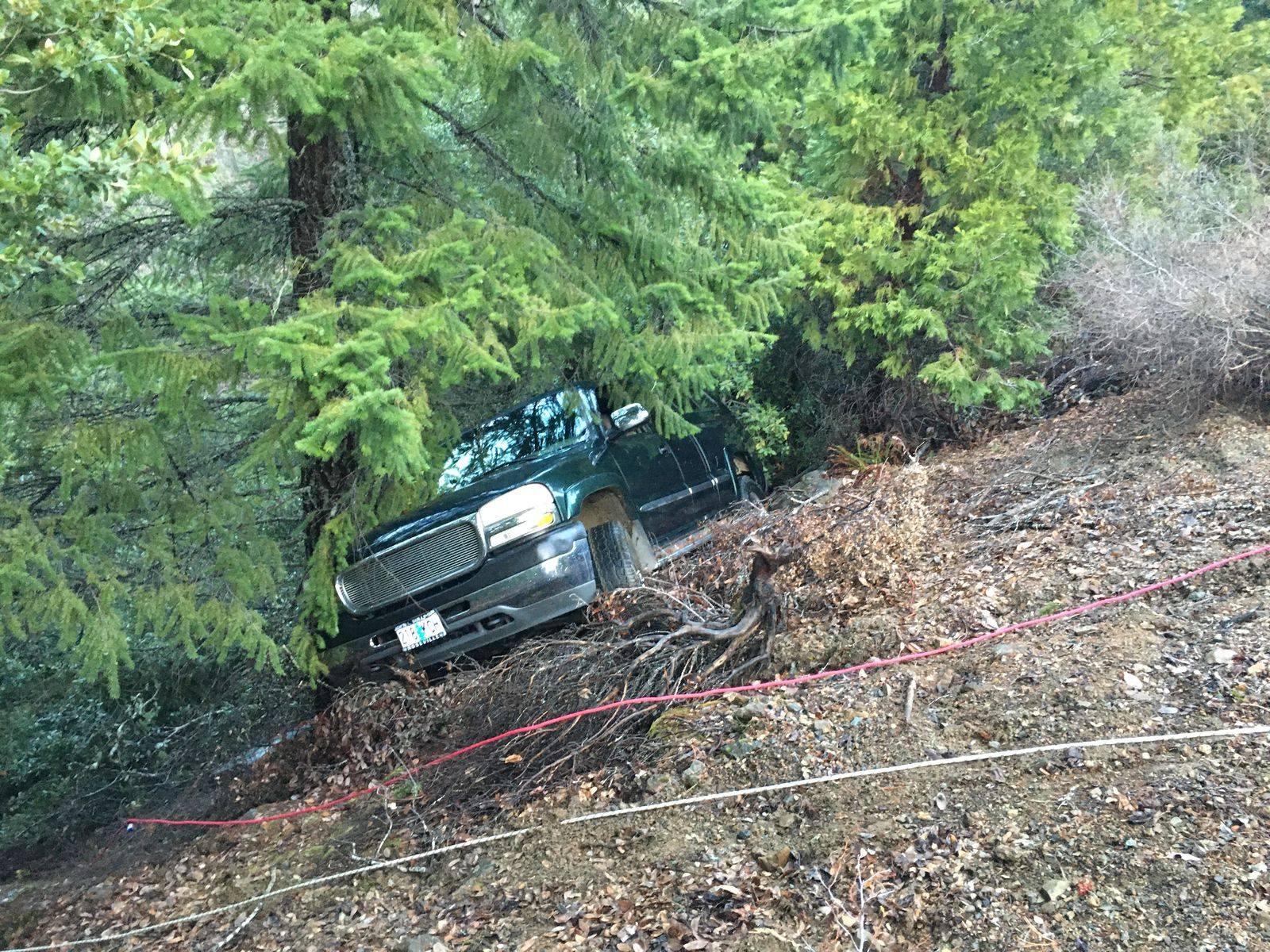 Christmas tree hunters spotted Russell Wilcox's truck down a 300 foot embankment Friday afternoon and called authorities who recovered the remains of the missing man Saturday morning. (Courtesy: Josephine County Sheriff's Office){ }