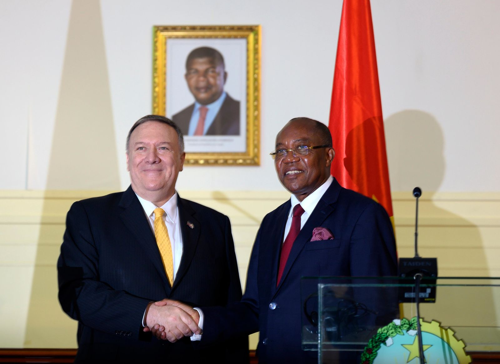 US Secretary of State, Mike Pompeo, left, and Angola Foreign Minister, Manuel Domingos Augusto hold a press conference in Luanda, Angola, Monday Feb. 17, 2020.{ } (Andrew Caballero-Reynolds/Pool via AP)