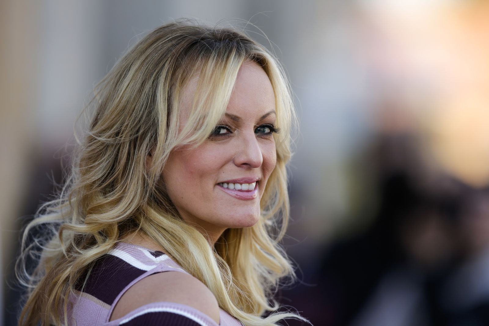 FILE - In this Oct. 11, 2018, file photo, adult film actress Stormy Daniels attends the opening of the adult entertainment fair 'Venus' in Berlin, Germany. Search warrants unsealed Thursday, Jul 18, 2019, shed new light on President Donald Trump's role as his campaign scrambled to respond to media inquiries about hush money paid to two women who said they had affairs with him.{ } (AP Photo/Markus Schreiber, File)