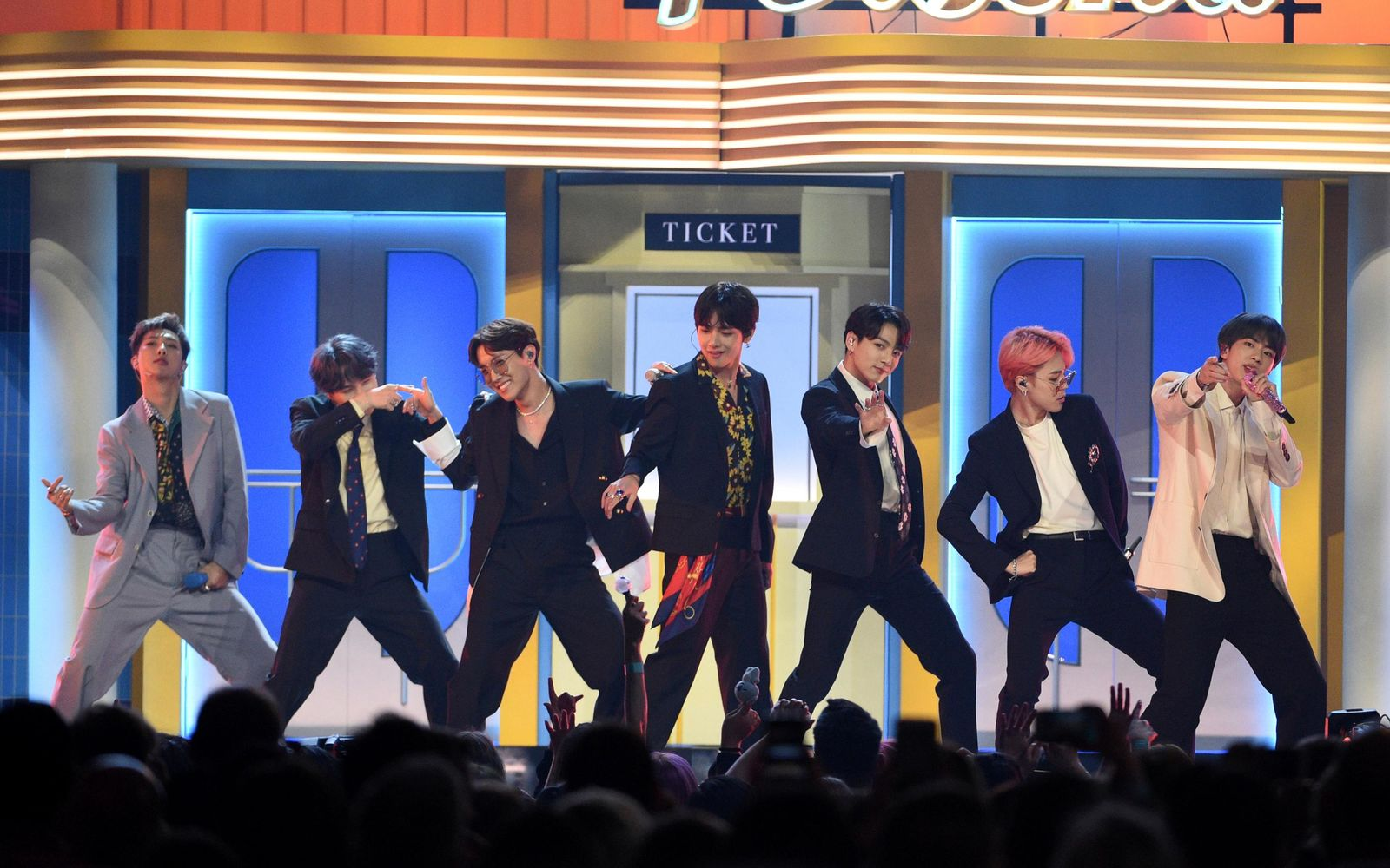 "FILE - This May 1, 2019 file photo shows BTS performing ""Boy With Luv"" at the Billboard Music Awards in Las Vegas. The Korean pop band is set to perform on the iHeartRadio Jingle Ball Tour this holiday season. IHeartMedia announced Friday, Sept. 27, 2019, that the 12-city tour kicks off Dec. 1 in Tampa Bay, Florida. (Photo by Chris Pizzello/Invision/AP, File)"