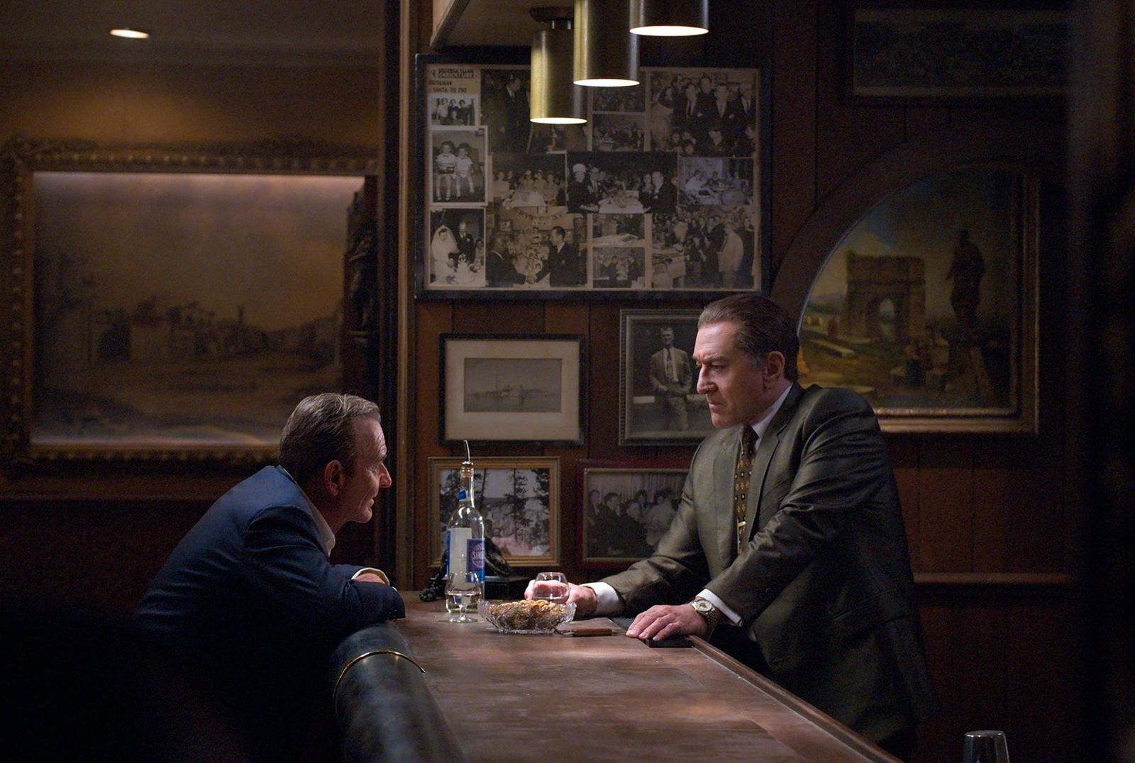 "This image released by Netflix shows Joe Pesci, left, and Robert De Niro in a scene from ""The Irishman.""  AARP has released nominations for its annual Movies for Grownups awards, which is designed to reward films that resonate with older viewers and fight industry ageism. (Niko Tavernise/Netflix via AP)"