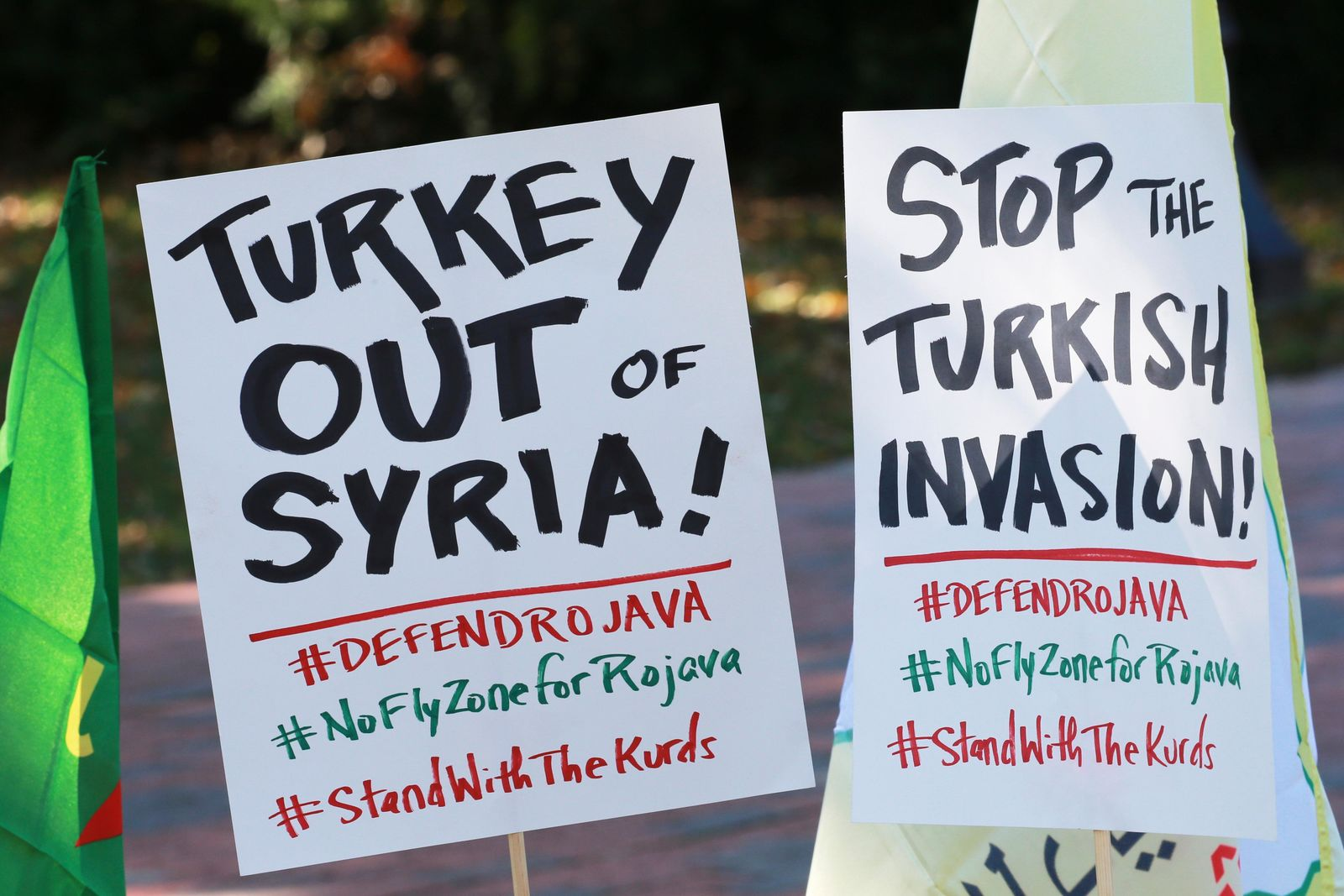 A small group of protesters post signs as they prepare for a rally against Turkish President Recep Tayyip Erdogan at Lafayette Square in front of the White House in Wednesday, Nov. 13, 2019, in Washington. Erdogan is meeting with President Donald Trump. (AP Photo/Steve Helber)